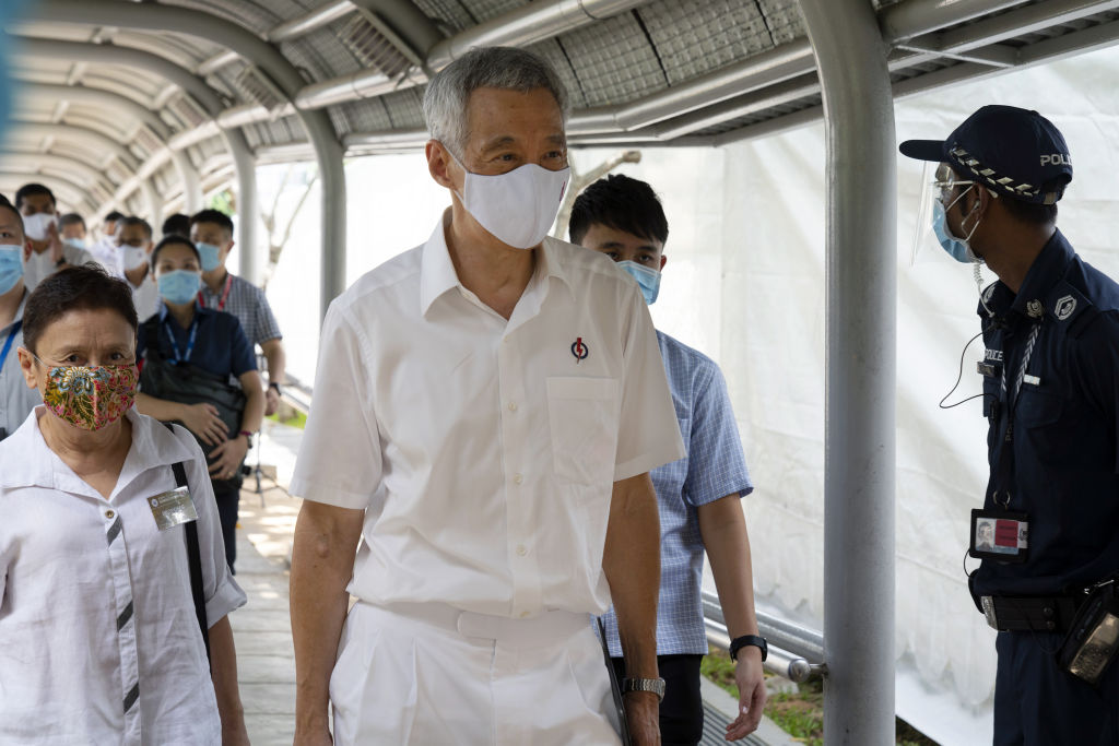 Lee Hsien Loong, Singapore's prime minister, departs a nomination center at the Deyi Secondary School in Singapore, on Tuesday, June 30, 2020. Lee Hsien Yang, the estranged younger brother of Singapore's Prime Minister Lee Hsien Loong, will not contest in the city-state's July 10 general elections, deflating the hype built up after he joined the opposition as the nine-day campaigning period kicked off.