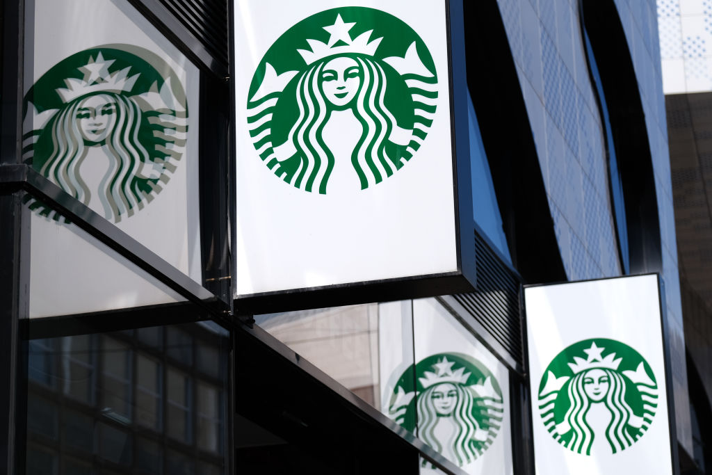 The Starbucks logo is reflected on a window outside the coffee chain's store on June 24, 2020 in The Hague, Netherlands.