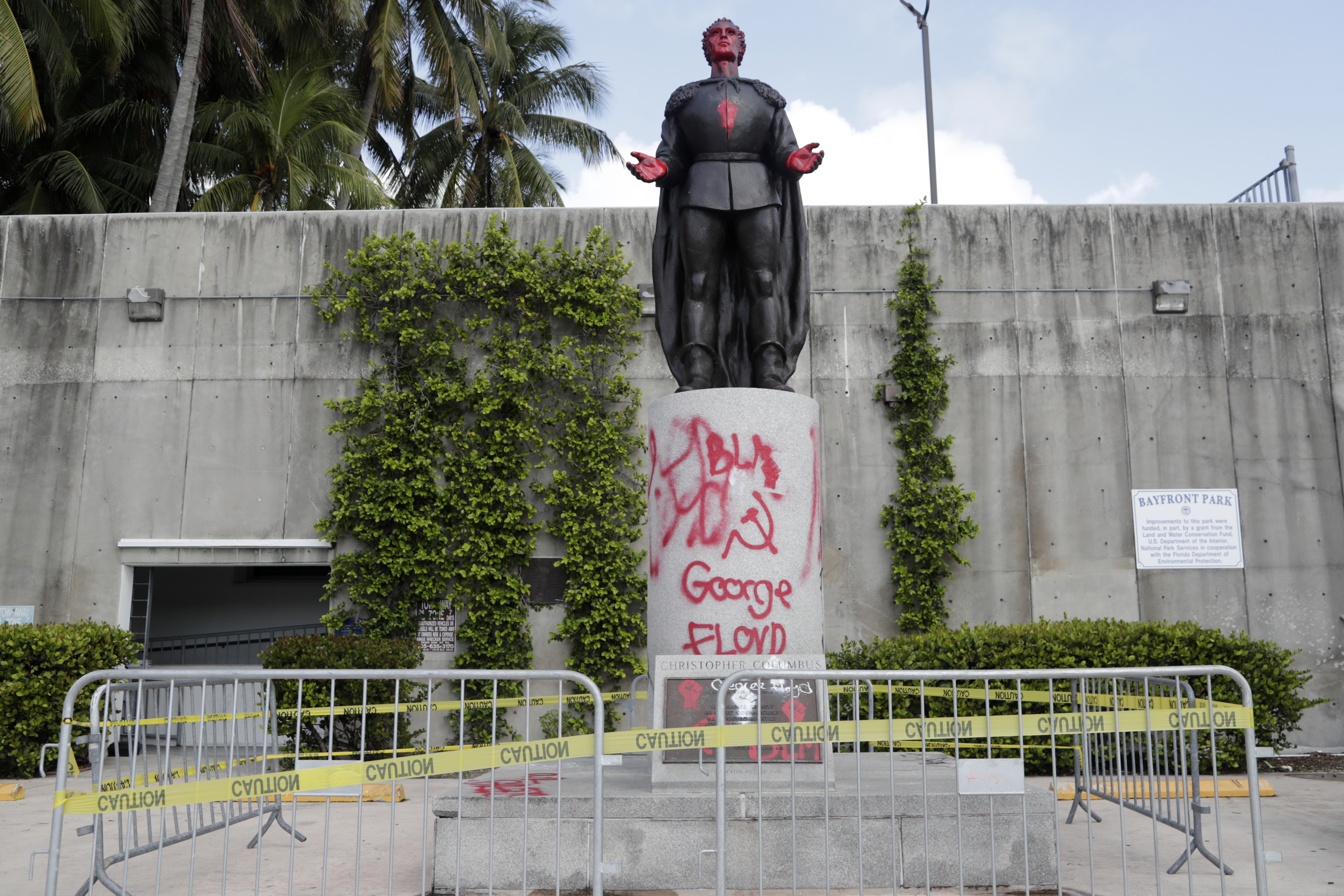 A statue of Christopher Columbus is shown vandalized at Bayfront Park in Miami, June 11, 2020.