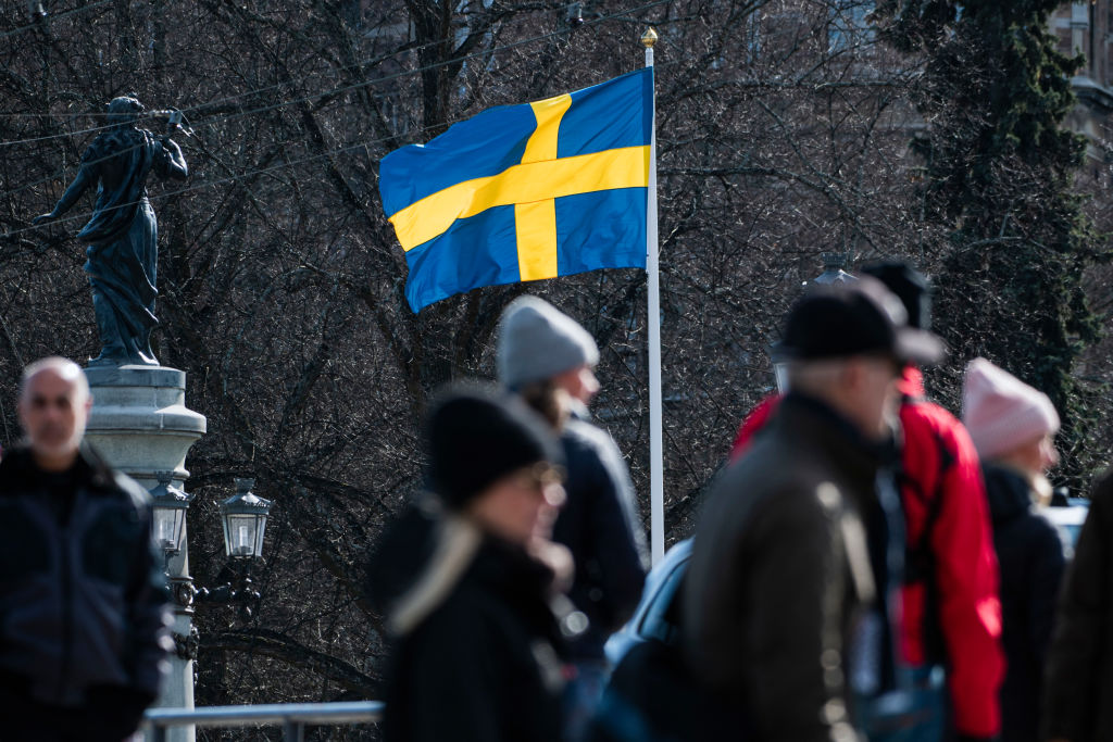The Swedish flag is seen in Stockholm on April 4, 2020.