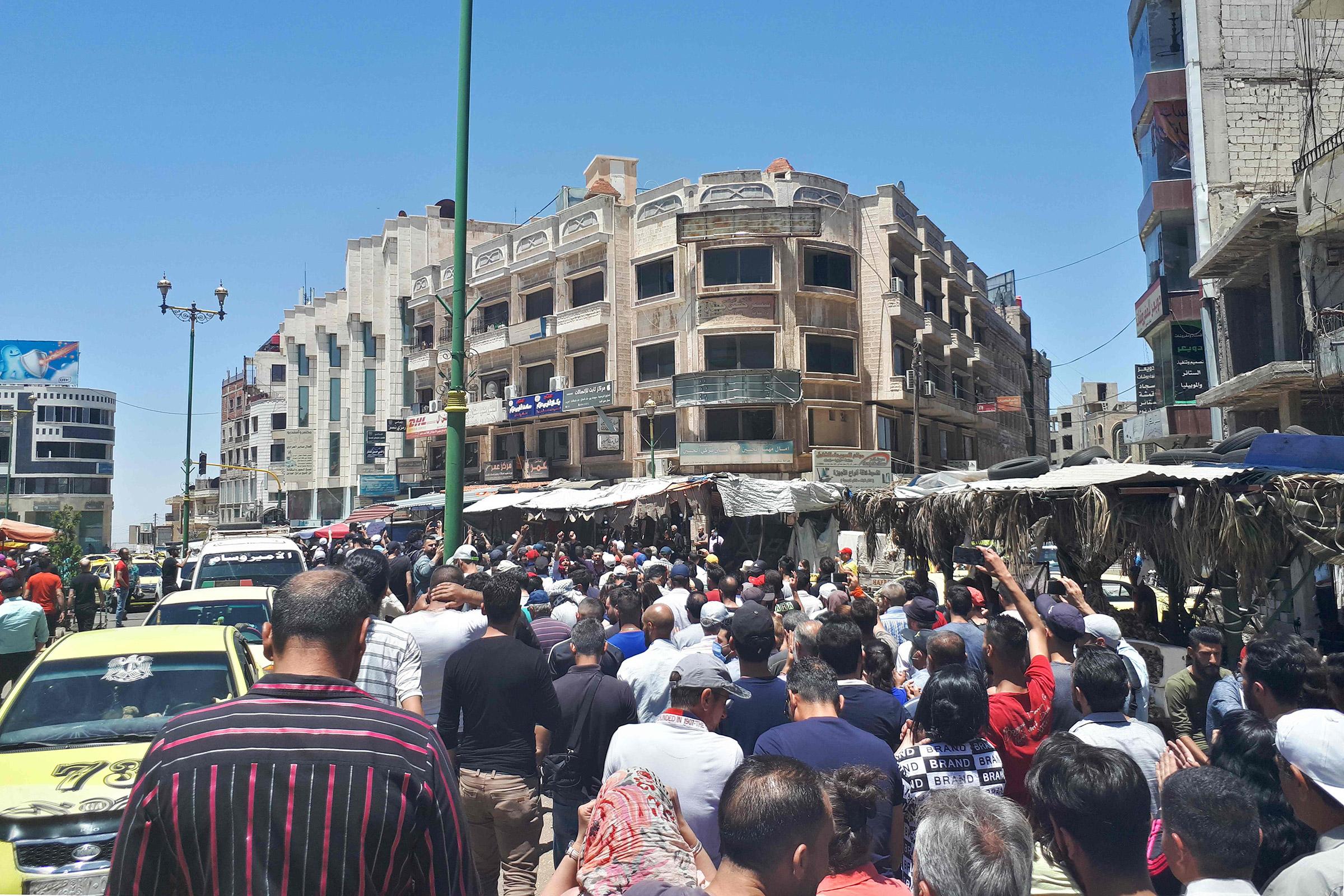 Protestors chant anti-government slogans in Suwaida, Syria on June 9, 2020.
