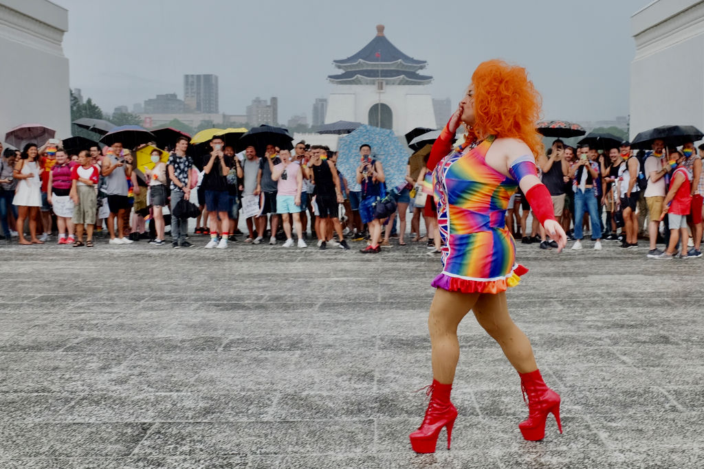 An LGBT rights activist poses for photos during a gay pride parade outside the Chiang Kai-shek Memorial Hall in Taipei on June 28, 2020.