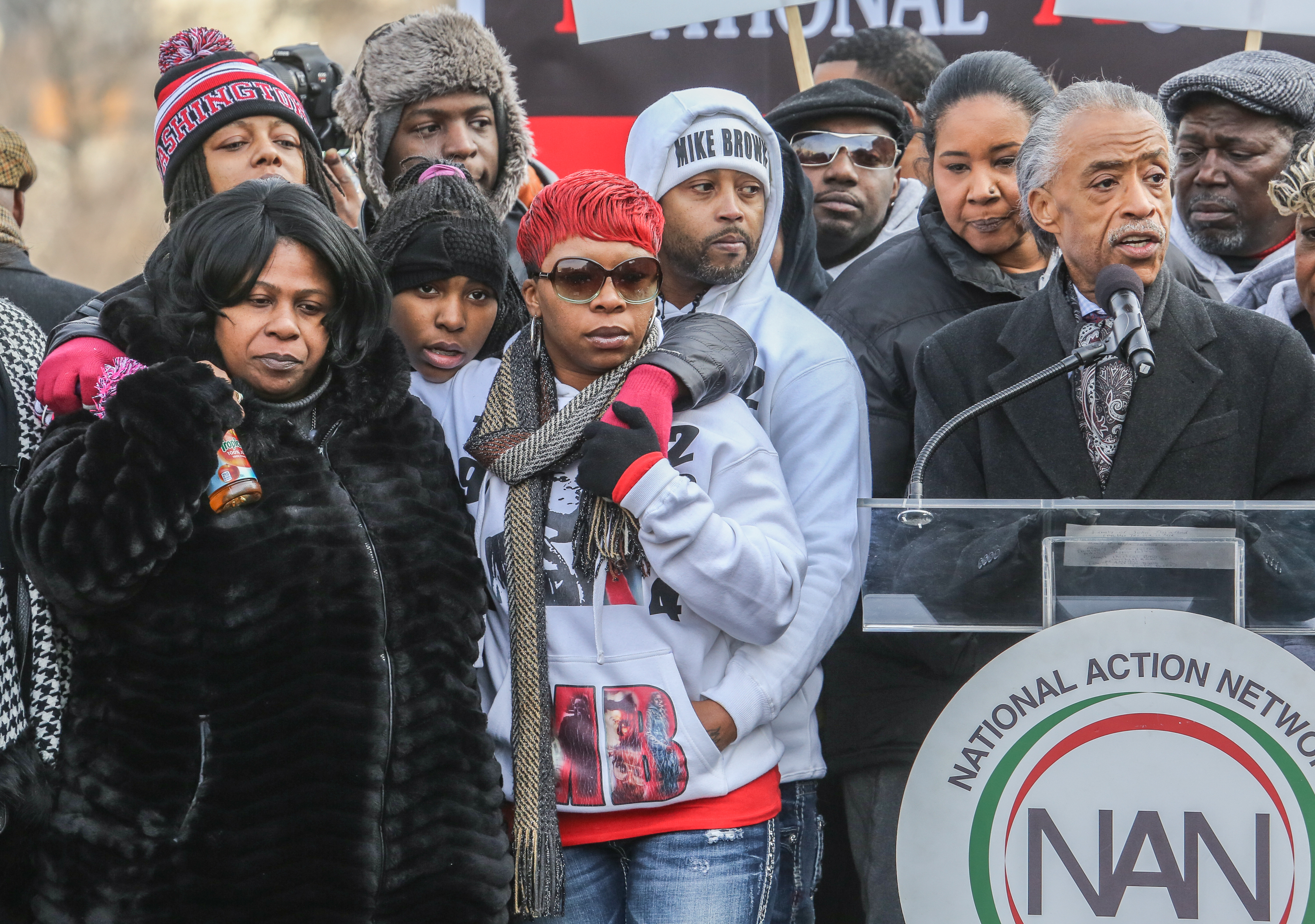 Samaria Rice (left), the mother of Tamir Rice, and Leslie McSpadden (right), the mother of Michael Brown, listen to Al Sharpton, at a march in Washington, D.C., on December 13, 2014.