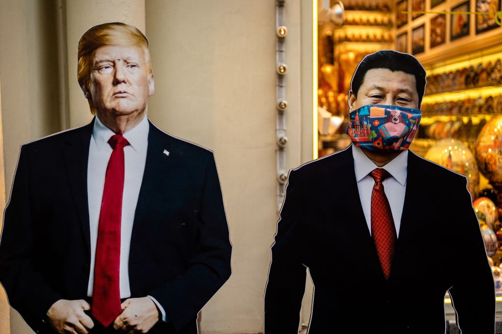 Cardboard figures of Chinese President Xi Jinping and U.S. President Donald Trump in front of a souvenir shop in downtown Moscow on June 3, 2020. China on June 1 accused the U.S. of  selfishness  after President Donald Trump said he would terminate the US relationship with the World Health Organization.