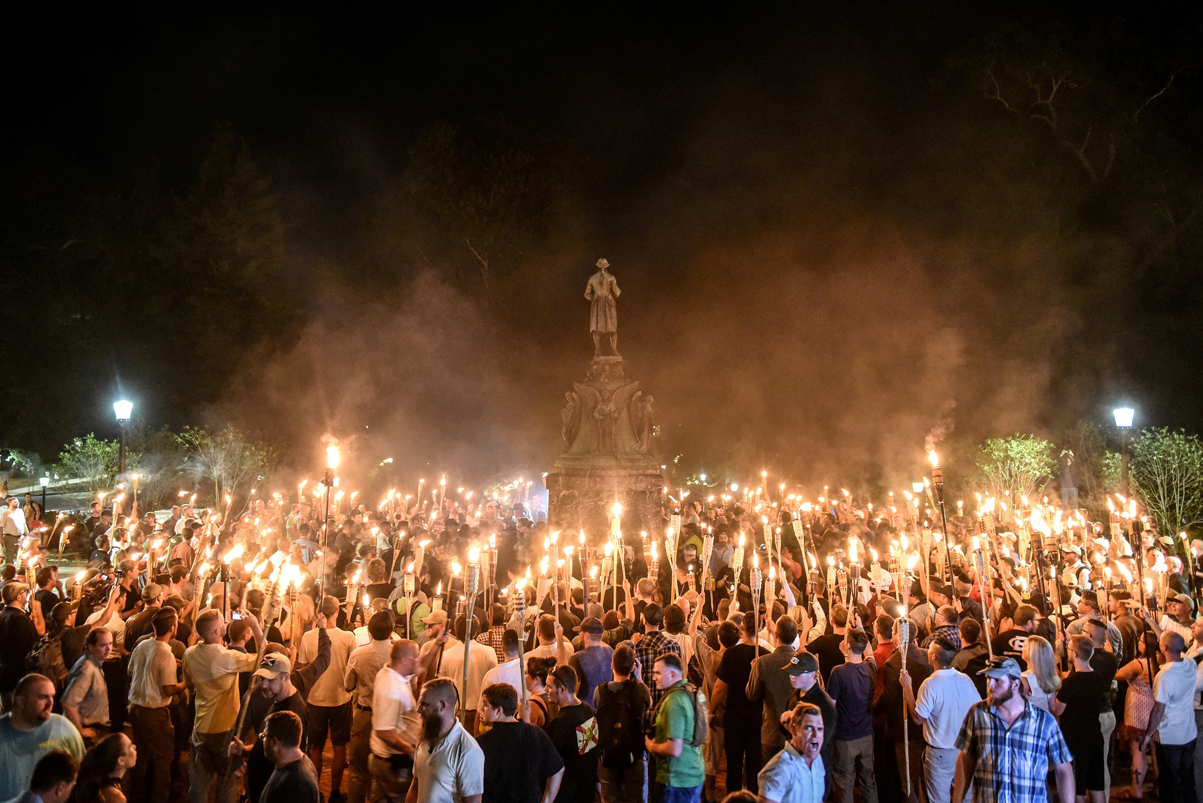 White nationalists participate in a torch-lit march on the grounds of the University of Virginia ahead of the Unite the Right Rally in Charlottesville, Virginia on Aug. 11, 2017