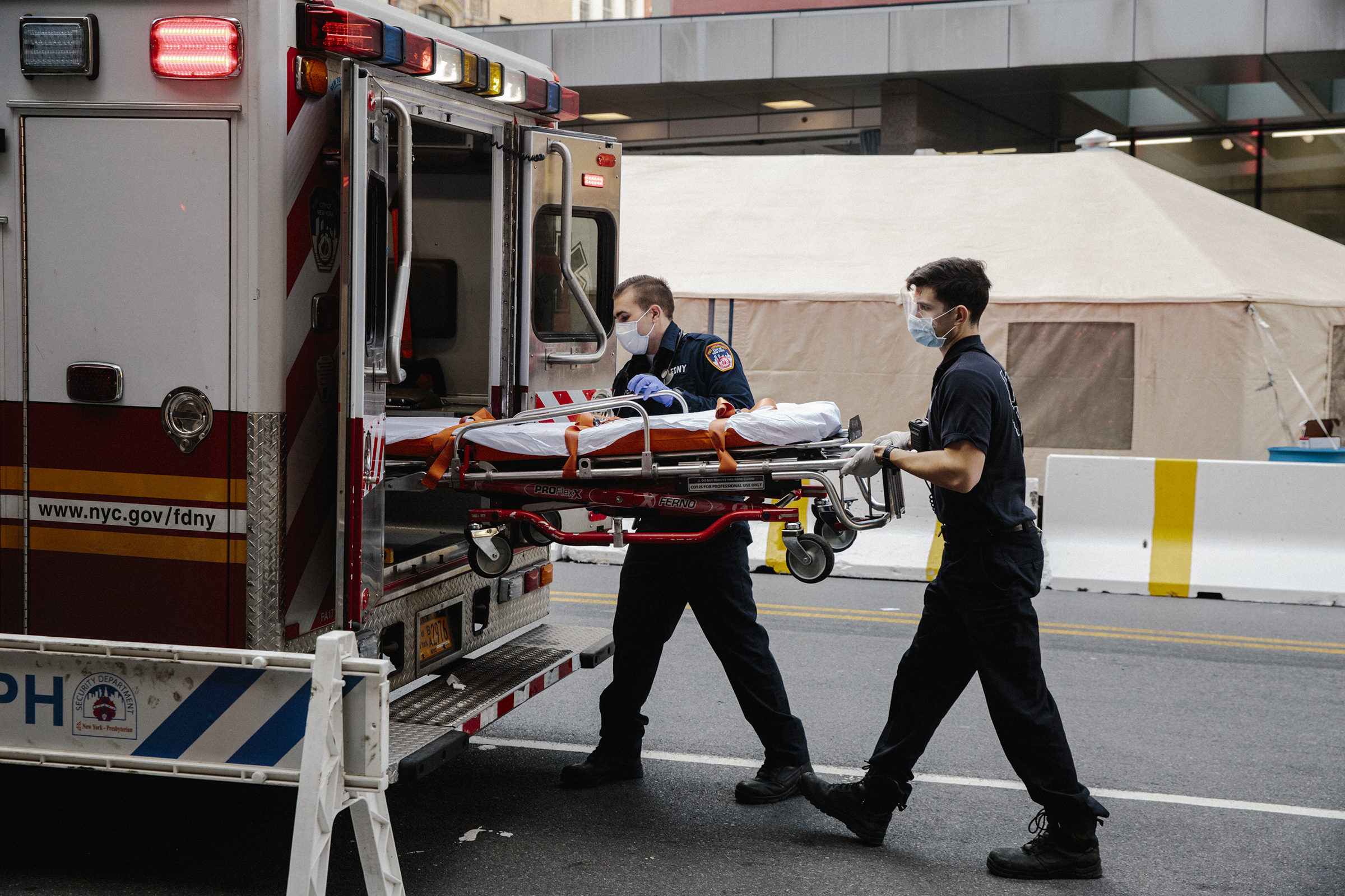 Emergency medical technicians after transporting a possible coronavirus patient outside of New York Presbyterian Lower Manhattan Hospital, on March 26, 2020.