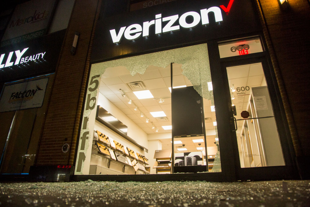 A Verizon store is seen damaged during a night of protests and vandalism over the death of George Floyd on June 1, 2020 in New York.