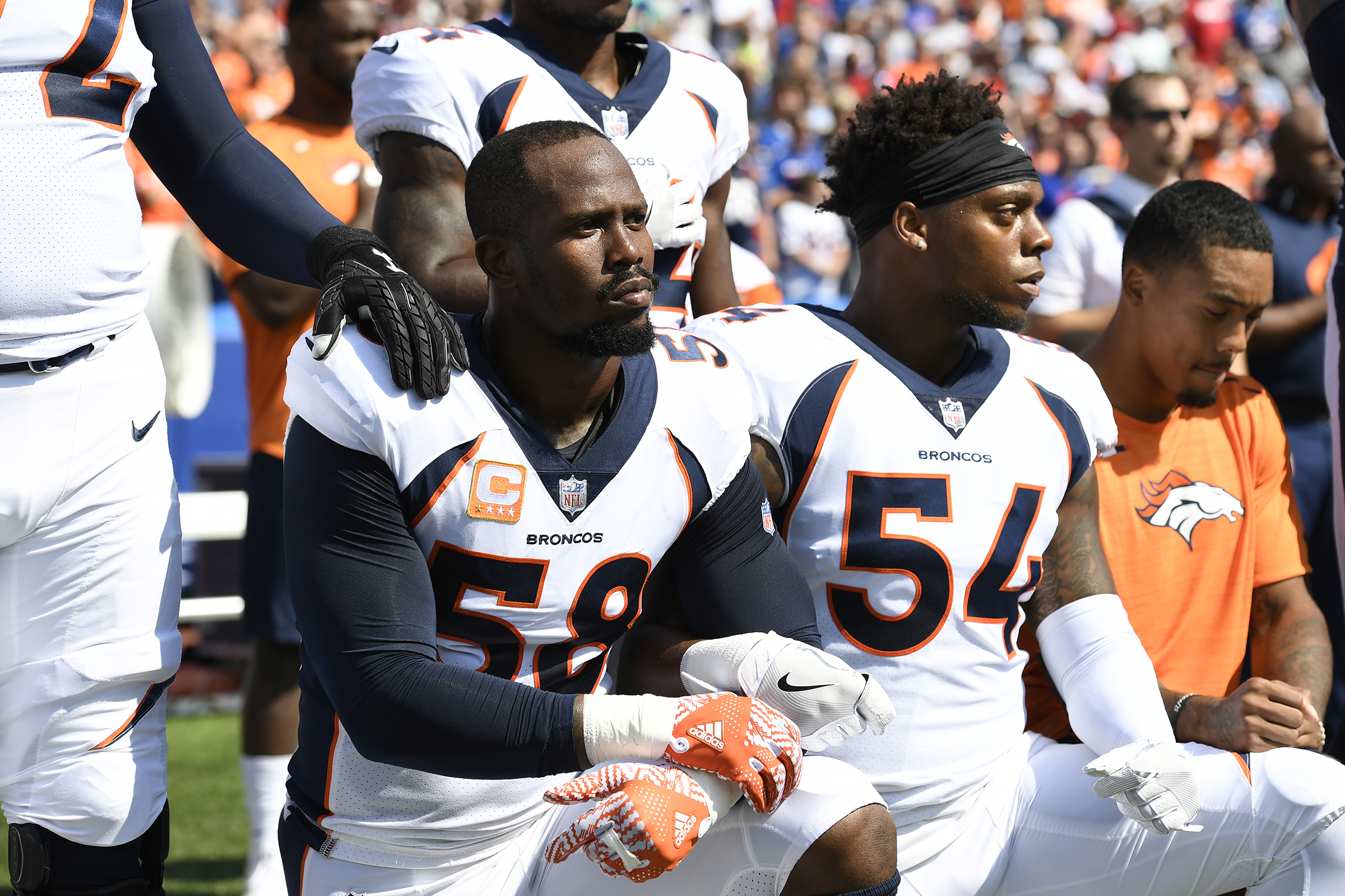Denver Broncos outside linebacker Von Miller (58) and inside linebacker Brandon Marshall (54) take a knee during the national anthem on September 24, 2017 at New Era Field in Orchard Park, NY.