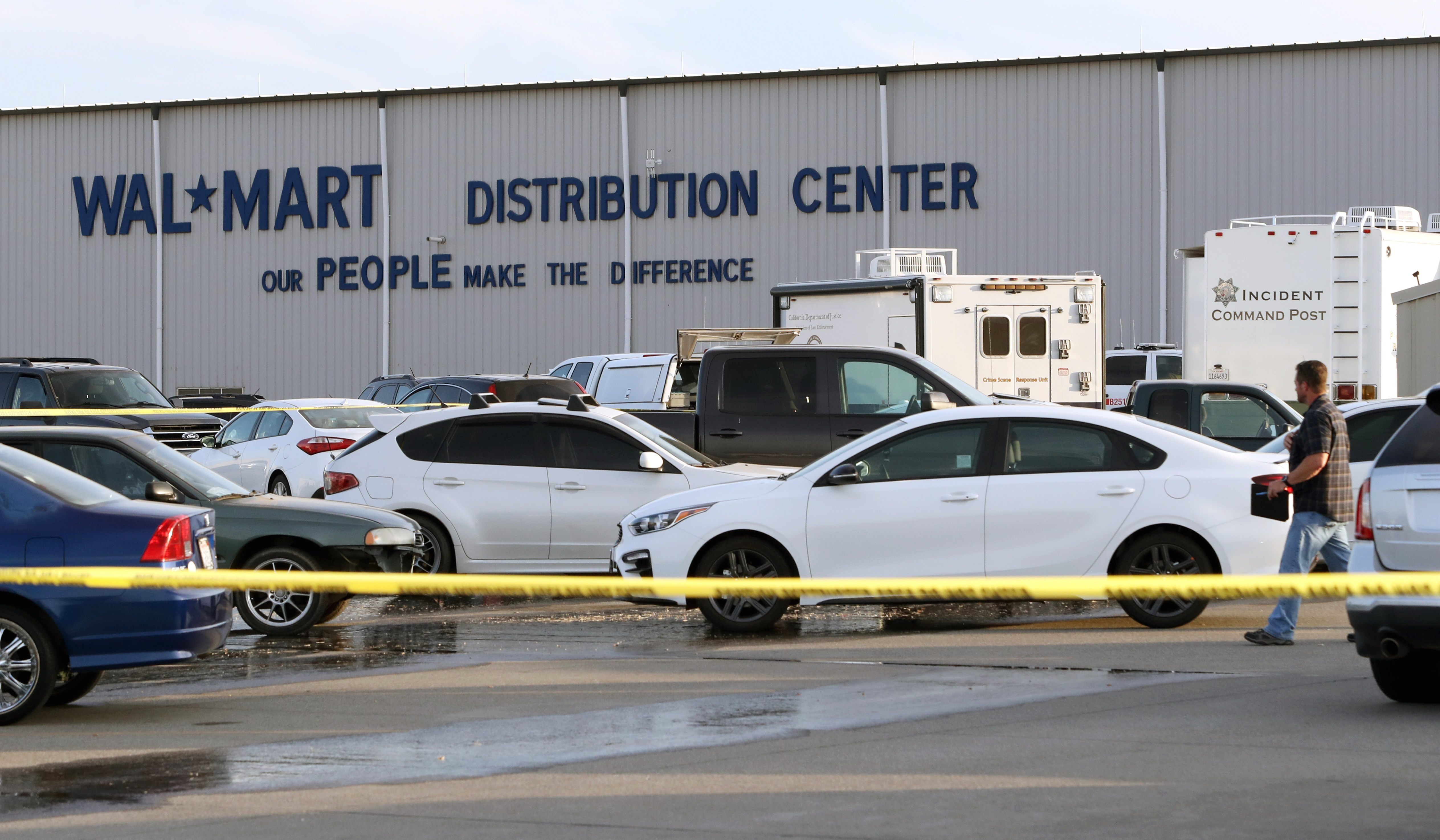 Crime tape blocks off a parking lot outside the Red Bluff Walmart Distribution Center where at least two people were killed, including a shooting suspect and an employee, and four were injured, June 27, 2020, in Red Bluff, Calif.