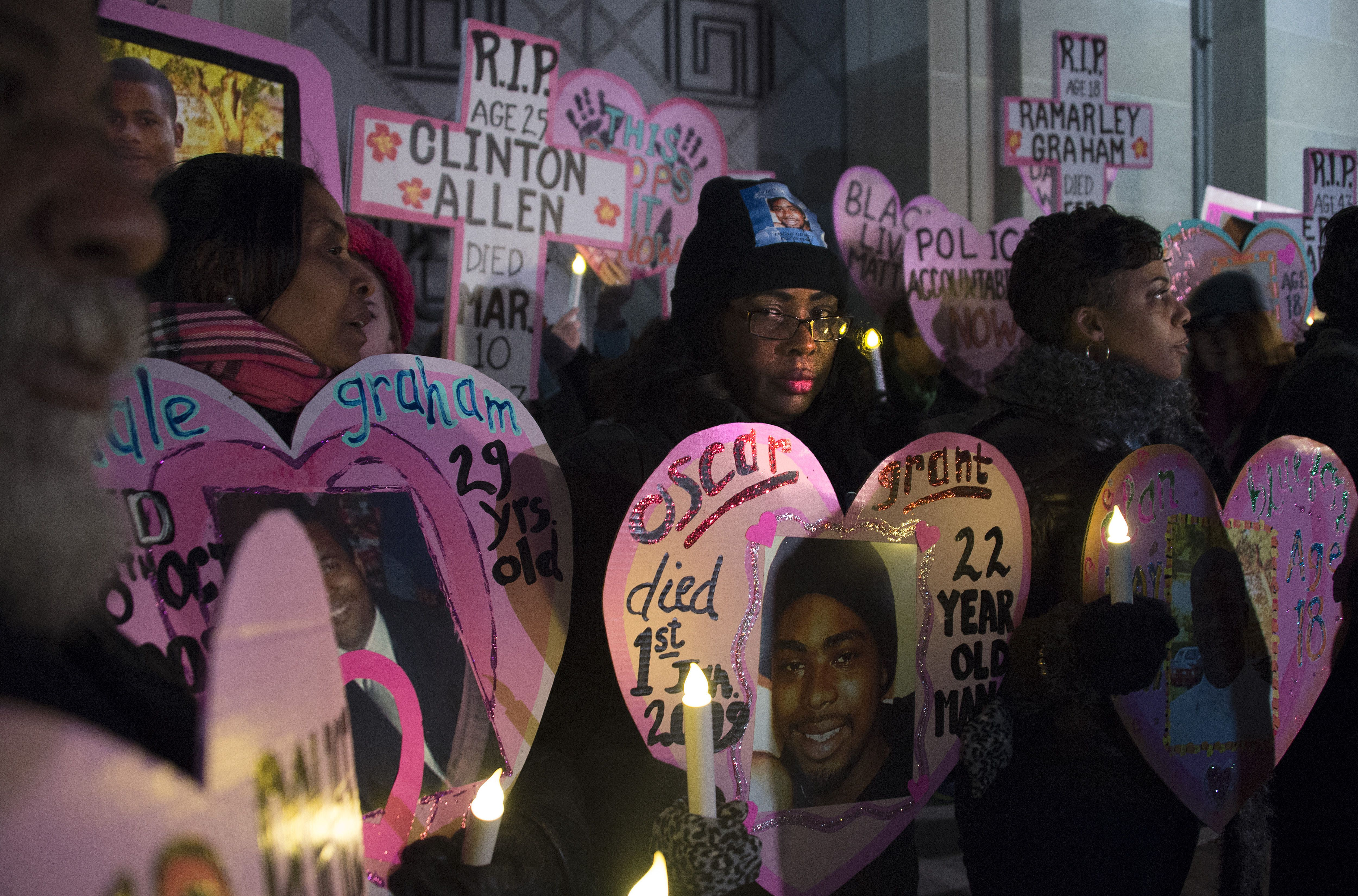 Wanda Johnson (center), whose son Oscar Grant was fatally shot in 2009 by a police officer in Oakland, California, stands with others during a vigil in Washington, D.C., on Dec. 10, 2014.
