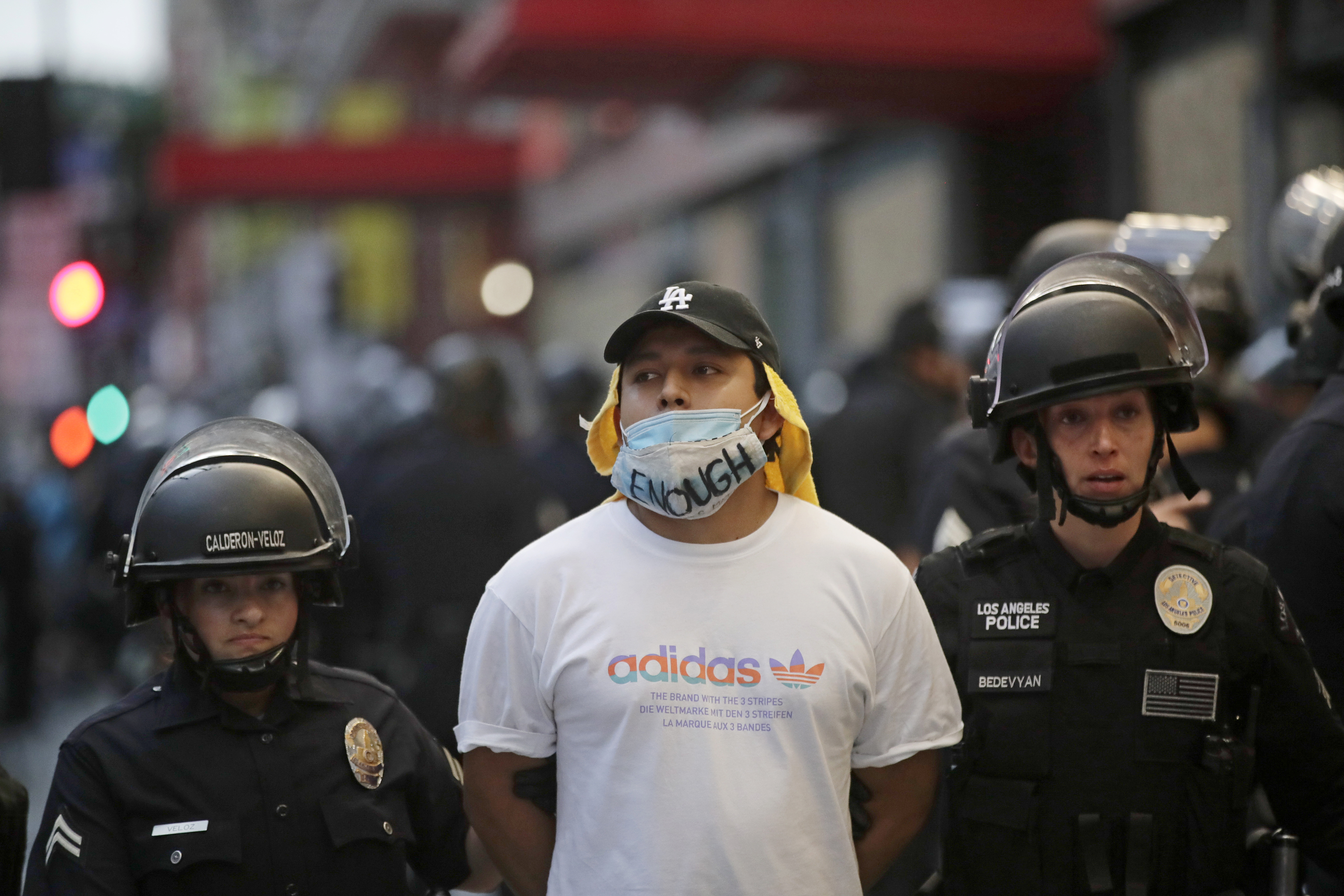 In this June 2, 2020, file photo, a demonstrator is taken into custody after a curfew went into effect in Los Angeles.
