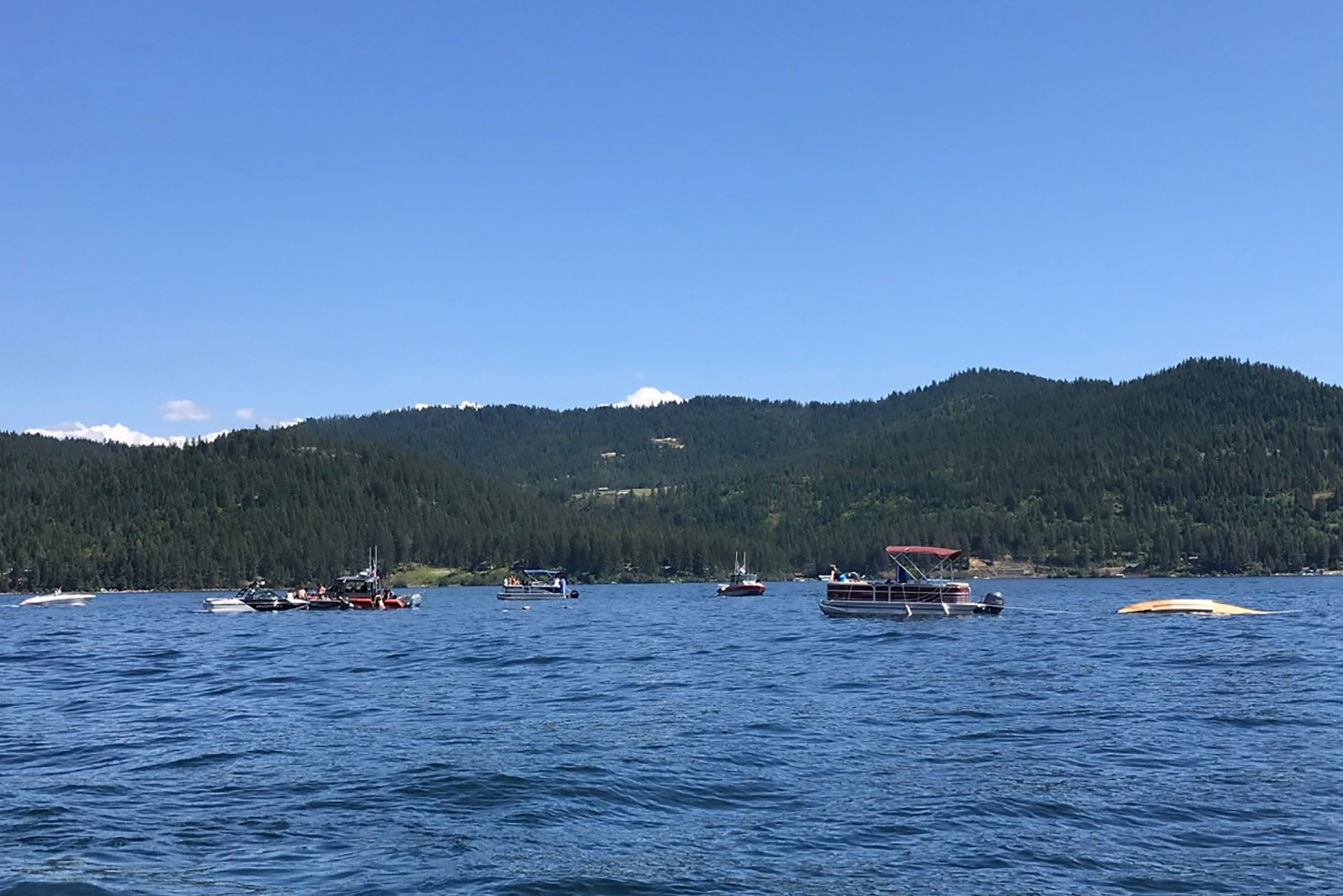 Boaters flag down authorities to a crashed seaplane near Powderhorn Bay on Lake Coeur d'Alene on July 5, 2020,