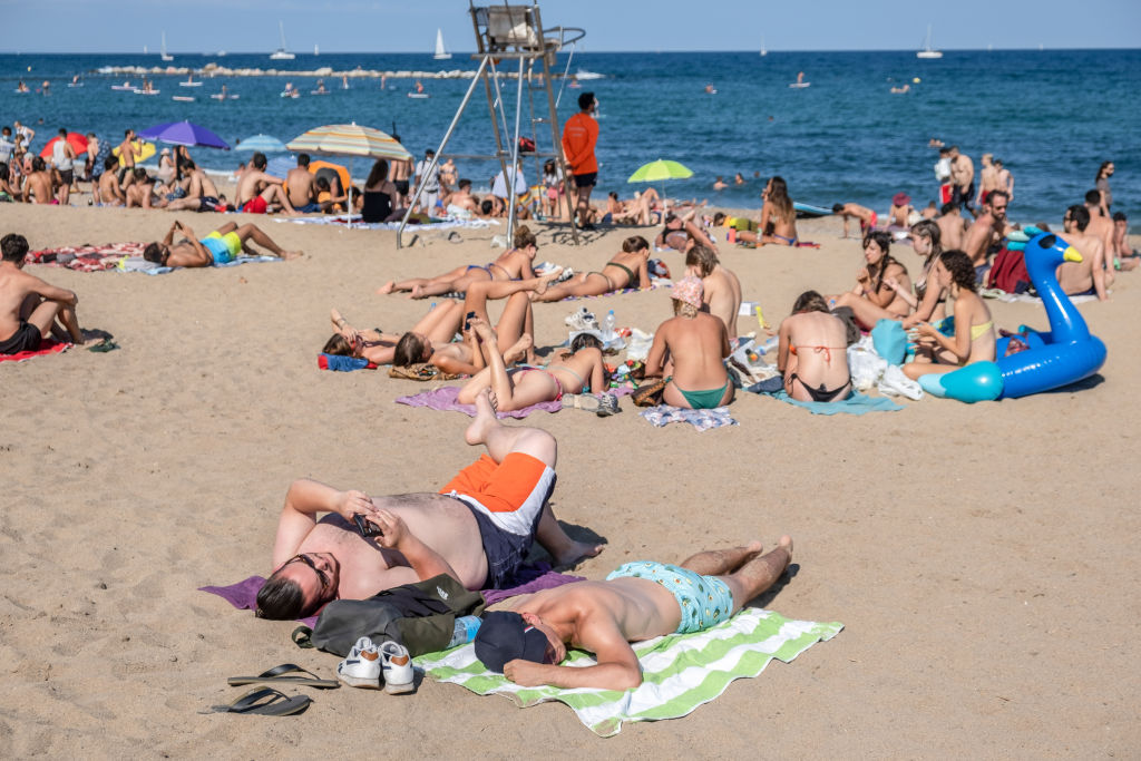 People are seen sunbathing at the Barceloneta beach during the coronavirus crisis.                 The city of Barcelona faces new outbreaks of coronavirus cases with new mobility restrictions and recommendations to avoid travelling outside the city.