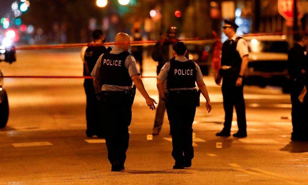 Chicago Police officers investigate the scene of a shooting in Chicago, Illinois, on July 21, 2020.