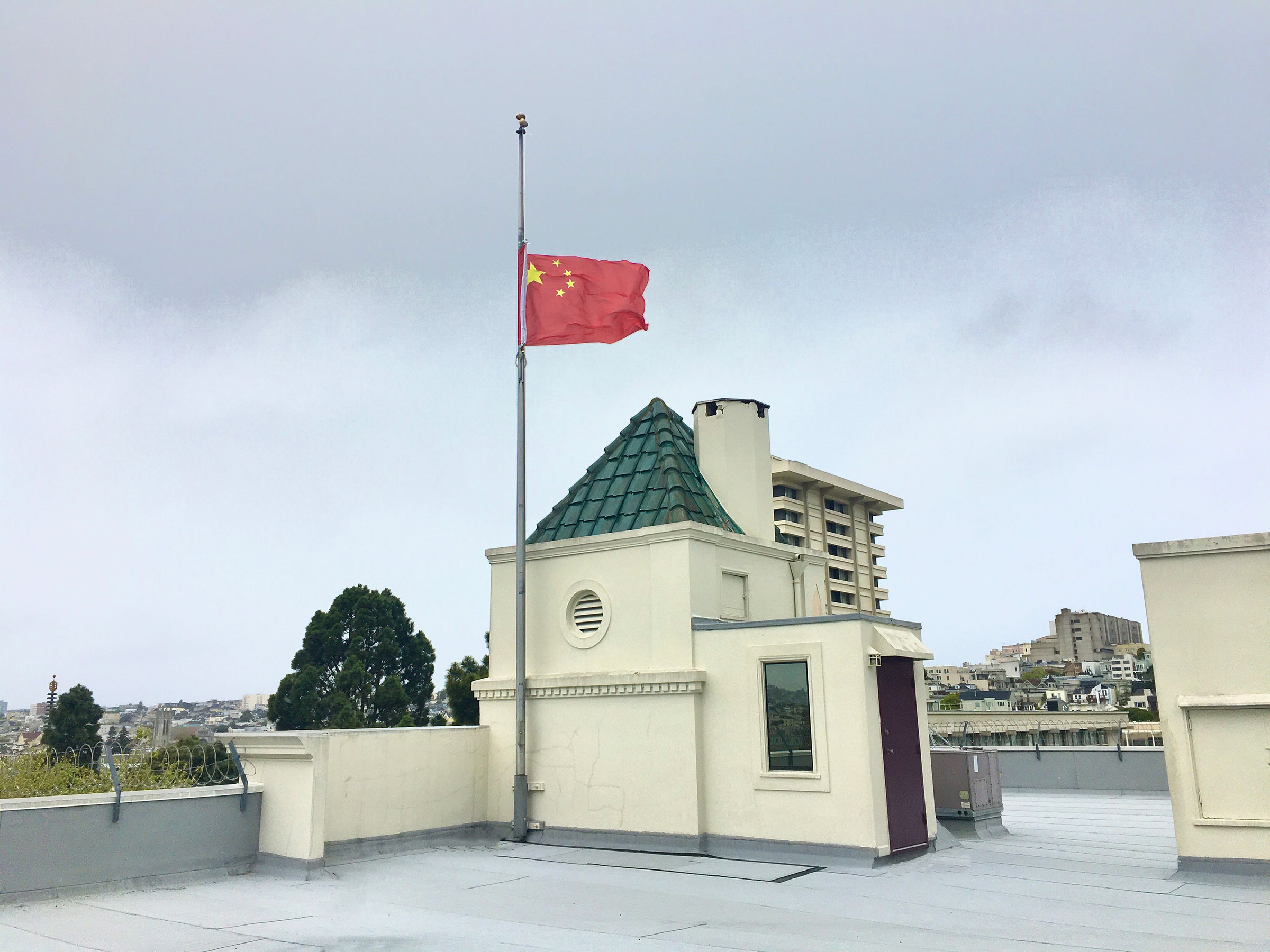 A Chinese national flag flies at half-mast to mourn for people who died in the fight against COVID-19 at the Consulate-General of the People's Republic of China in San Francisco on April 4, 2020.