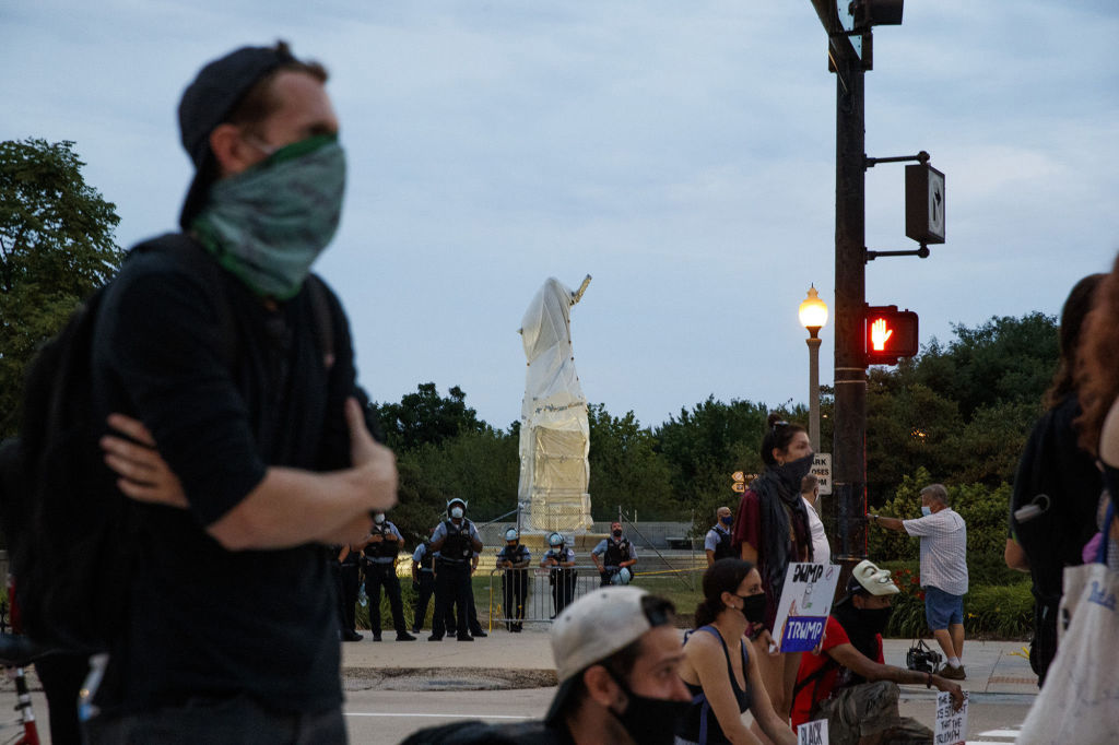 Activists stand at South Columbus Drive and East Roosevelt Road near the Christopher Columbus statue in Chicago on July 20, 2020.