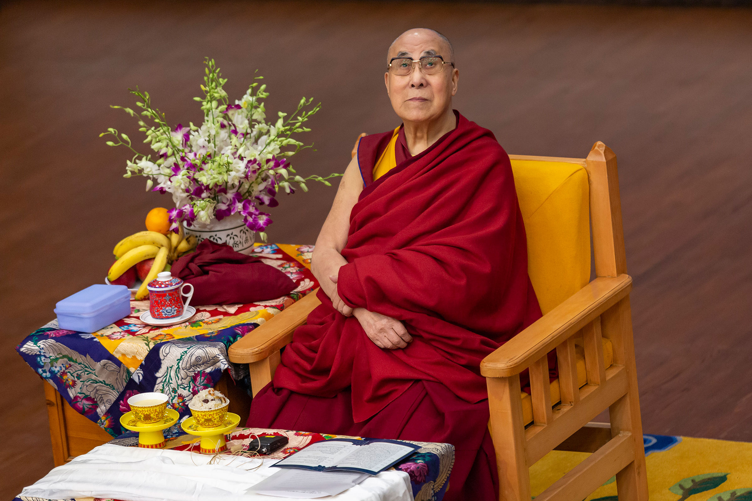 Tibetan spiritual leader the Dalai Lama looks on as he sits on his ceremonial chair at the Tibetan Institute of Performing Arts in Dharmsala, India, on Oct. 29, 2019.