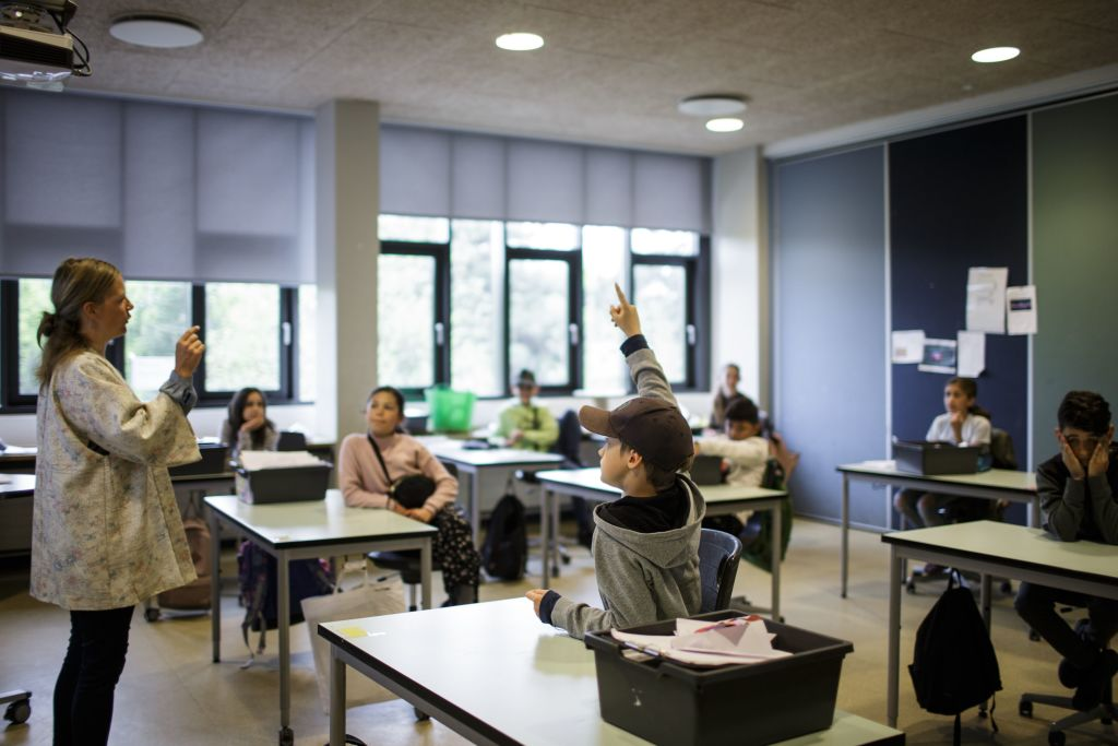 Teacher Marie Kaas-Larsen questions her pupils in a classroom rearrangered for social distancing at the Norrebro Park primary school in Copenhagen, Denmark on April 29, 2020. Denmark was the first country in Europe to reopen its schools for the youngest pupils on April 15. In addition to practicing social distancing and regular handwashing, classes must be held outdoors as much as possible to limit the spread of the virus.