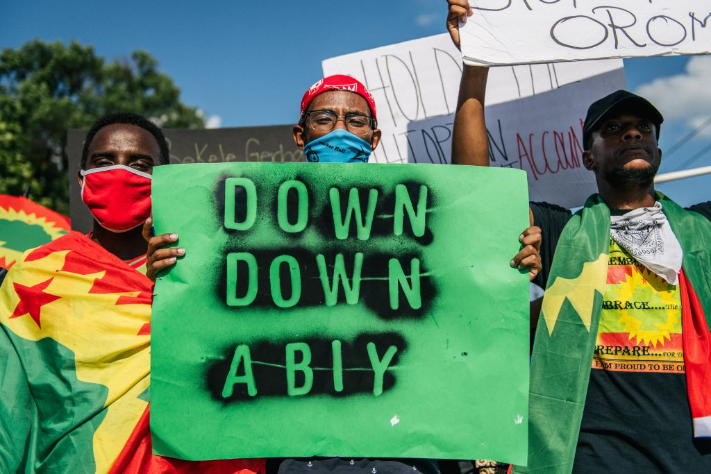 Members of the Oromo community march in protest after the death of musician and revolutionary Hachalu Hundessa on July 8, 2020 in St. Paul, Minnesota.