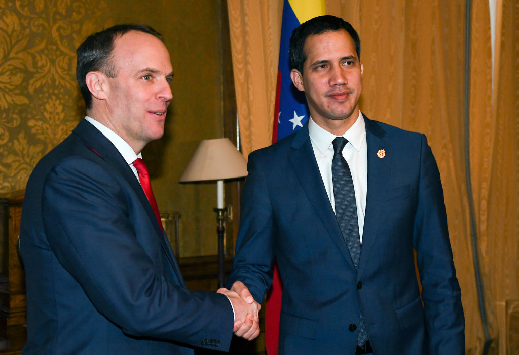Venezuela's Opposition leader Juan Guaido (R) shakes hands with British Foreign Secretary Dominic Raab at The Foreign & Commonwealth Office on January 21, 2020 in London, England.