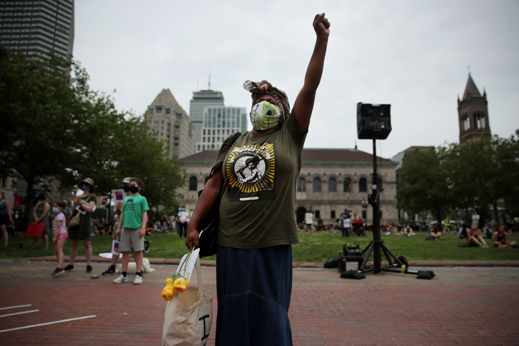 Janice Thomas, a mother of four, raises her fist during the March Like A Mother for Black Lives rally in Boston in June.