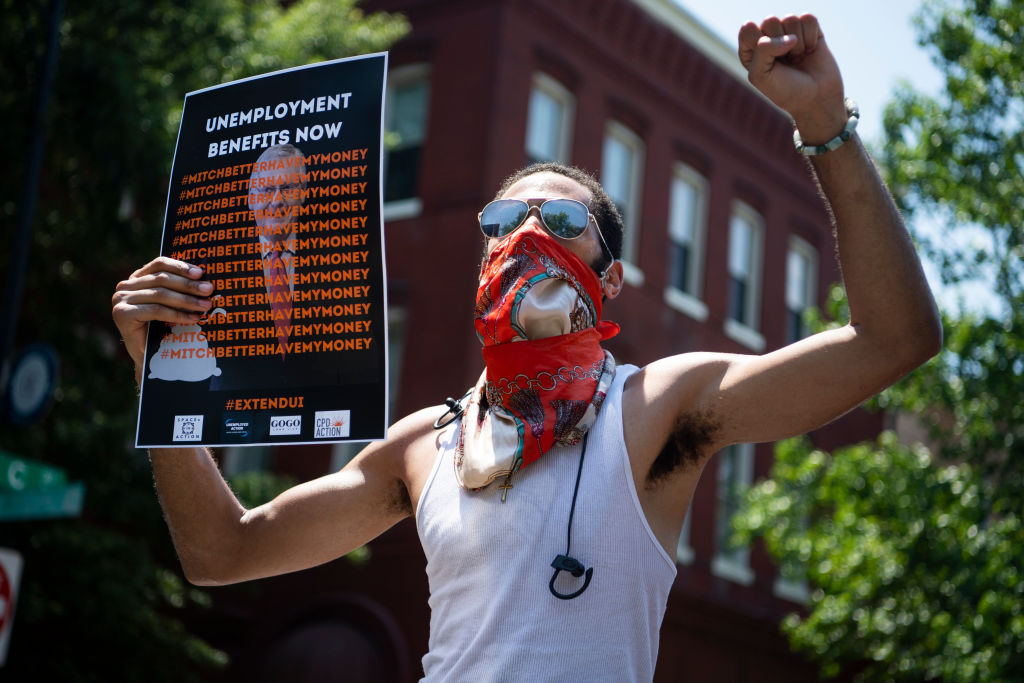 Demonstrators rally on July 22 near the Capitol Hill residence of Senate Majority Leader Mitch McConnell to call for the extension of unemployment benefits.
