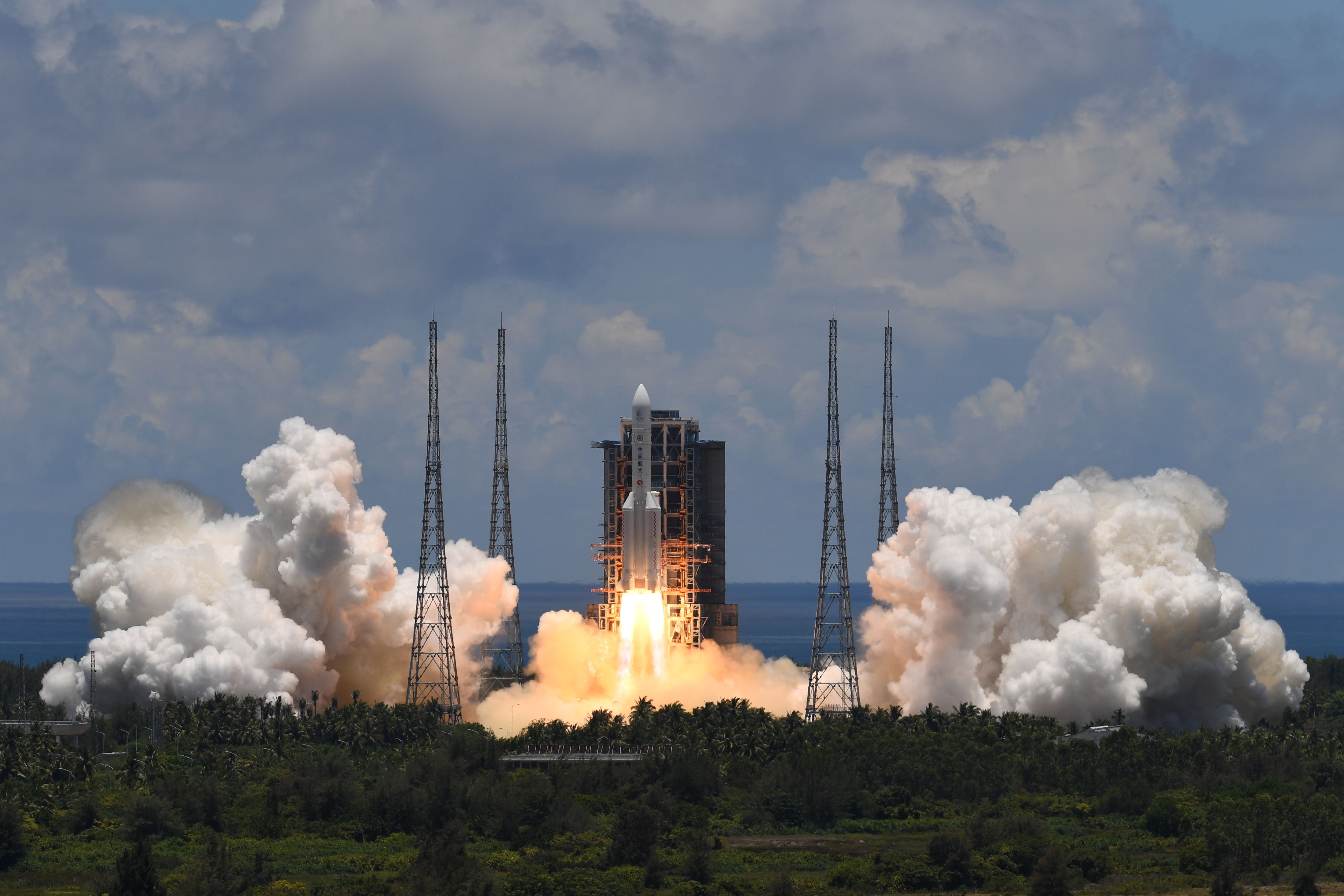 A Long March-5 rocket, carrying an orbiter, lander and rover as part of the Tianwen-1 mission to Mars, lifts off from the Wenchang Space Launch Centre in southern China's Hainan Province on July 23, 2020.