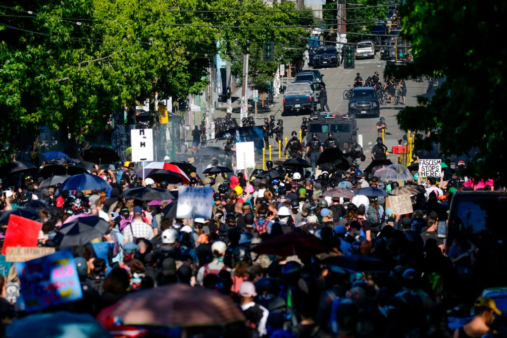 Protesters confront police at the former location of the Capitol Hill Organized Protest (CHOP) after a  Youth Day of Action and Solidarity with Portland  demonstration in Seattle,  Wash., on July 25, 2020.