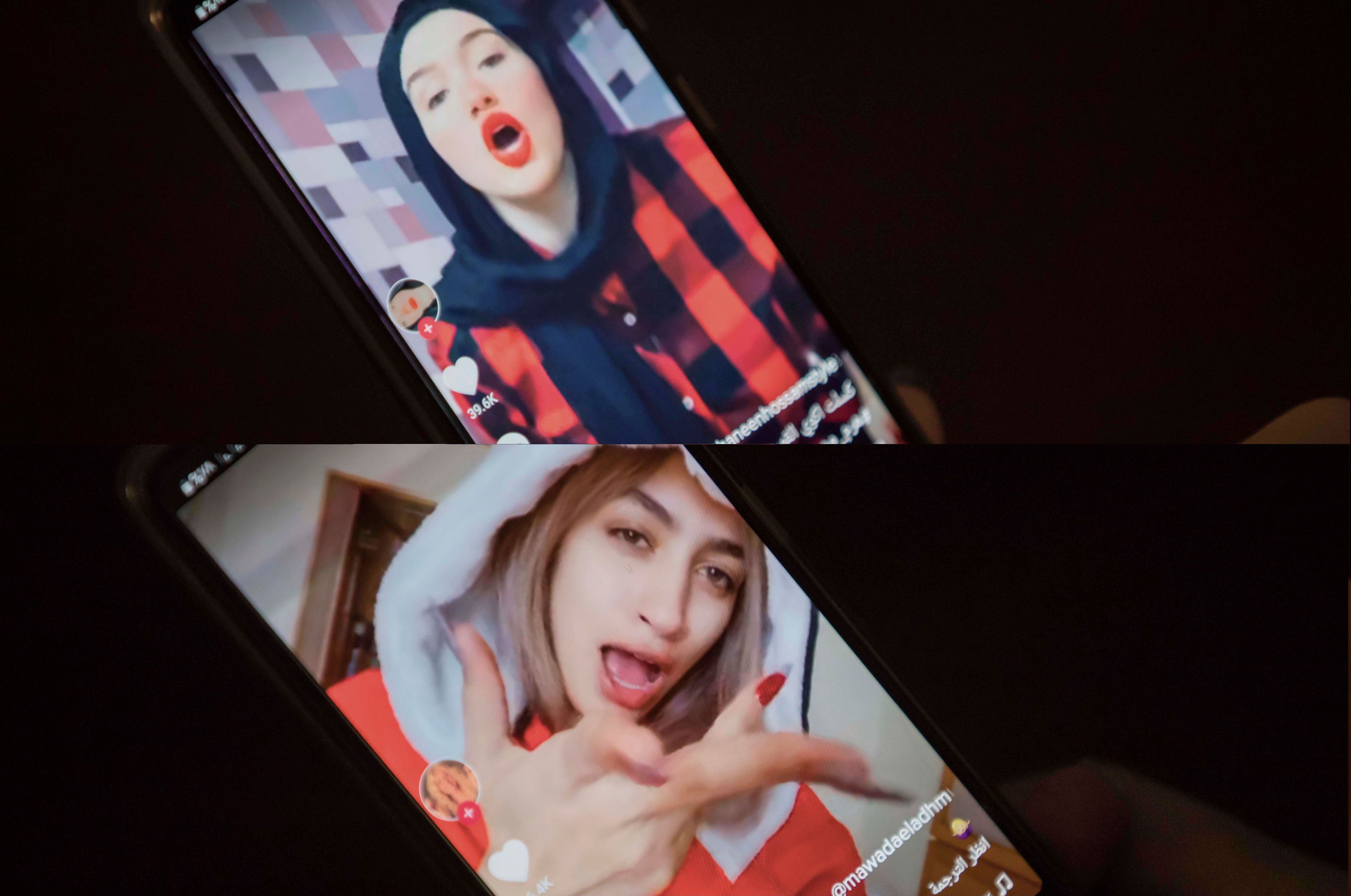 TikTok videos shared by Egyptian influencers Haneen Hossam (top) and Mowada al-Adham (bottom), being viewed in Cairo, Egypt on July 28, 2020.