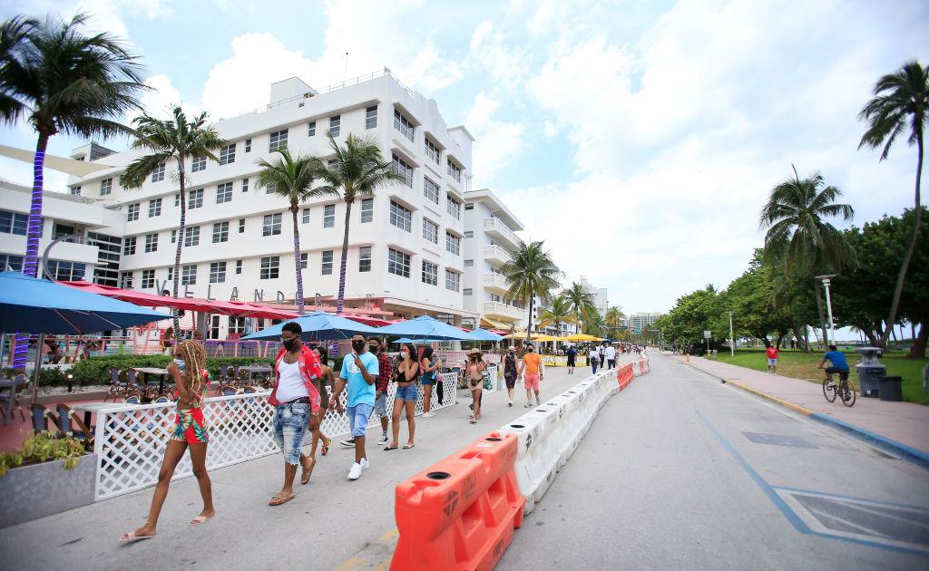 People walk down Ocean Drive in the South Beach neighborhood of Miami Beach, Florida, on July 4, 2020