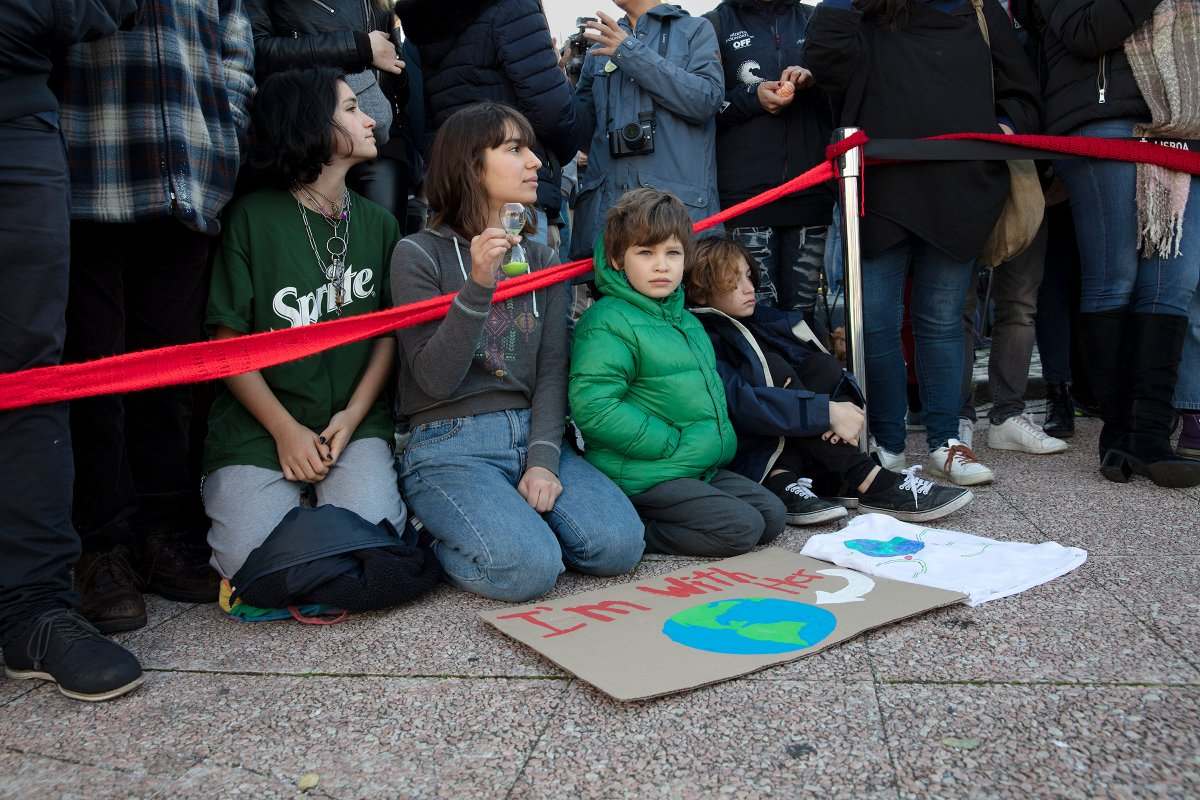 Young supporters of Greta Thunberg await her arrival in Santo Amaro Recreation dock on December 03, 2019 in Lisbon, Portugal.