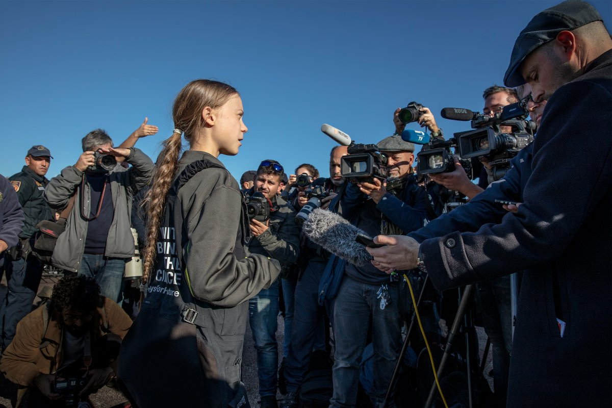 Greta Thunberg addresses supporters and journalists upon her arrival in Santo Amaro Recreation dock on December 03, 2019 in Lisbon, Portugal.