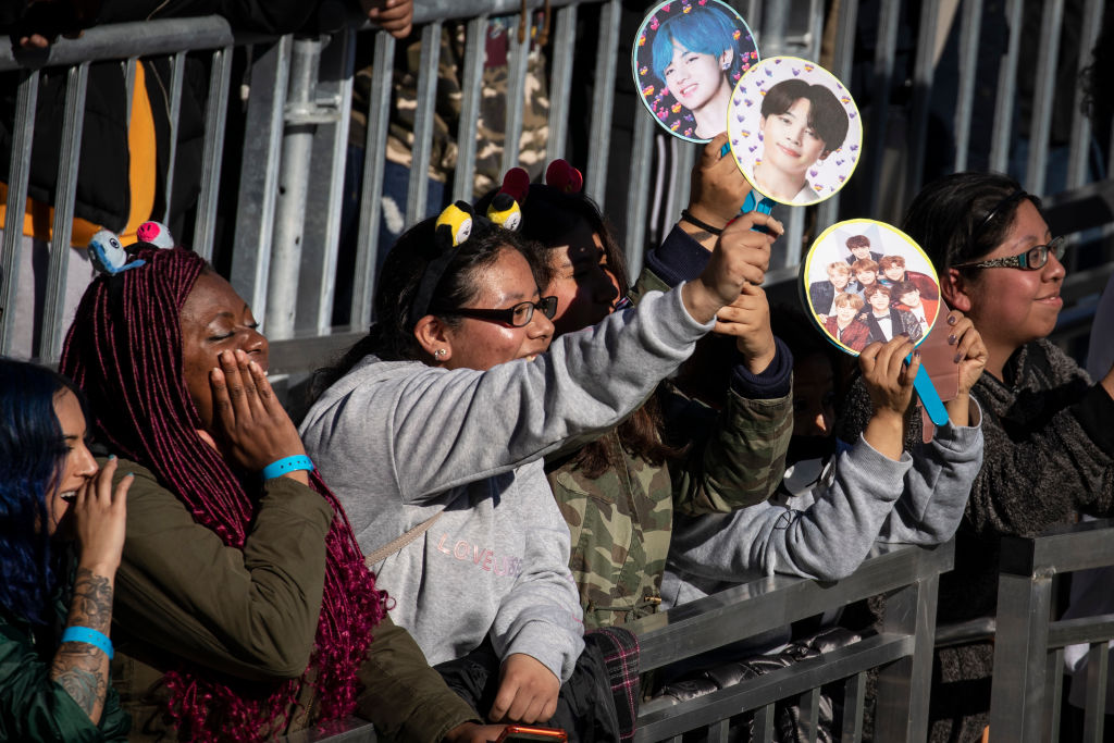 Fans cheer as K-Pop group BTS performs in Central Park, May 15, 2019 in New York City. Fans waited in line for days to see the group perform as part of ABC's 'Good Morning America' summer concert series.