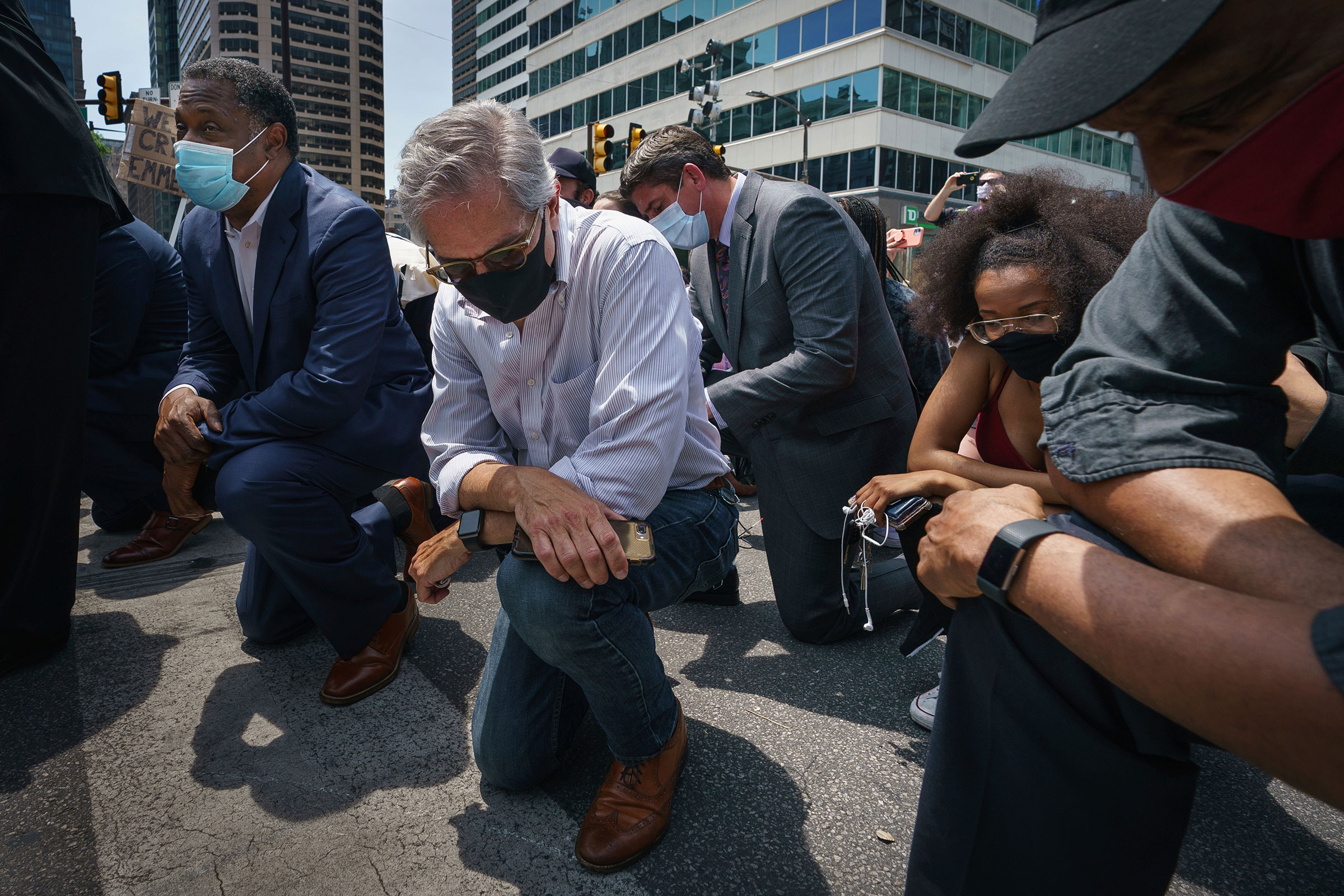Philadelphia District Attorney Larry Krasner takes a knee in honor of the memory of George Floyd on June 4, 2020, in Philadelphia.