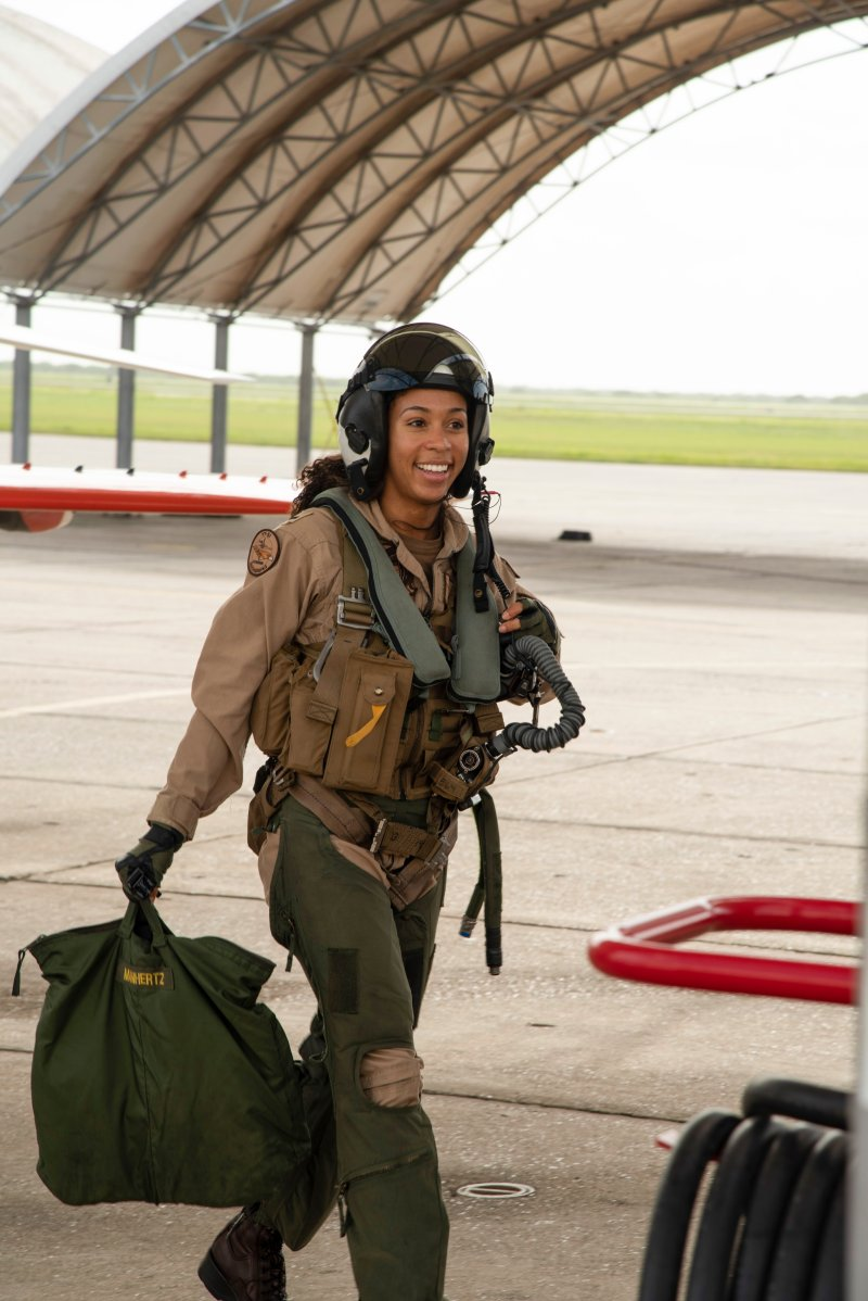 Student Naval Aviator Lt. j.g. Madeline Swegle, assigned to the Redhawks of Training Squadron (VT) 21 at Naval Air Station Kingsville, Texas, exits a T-45C Goshawk training aircraft following her final flight to complete the undergraduate Tactical Air (Strike) pilot training syllabus, July 7. Swegle is the U.S. Navy's first known Black female strike aviator and will receive her Wings of Gold during a ceremony July 31.