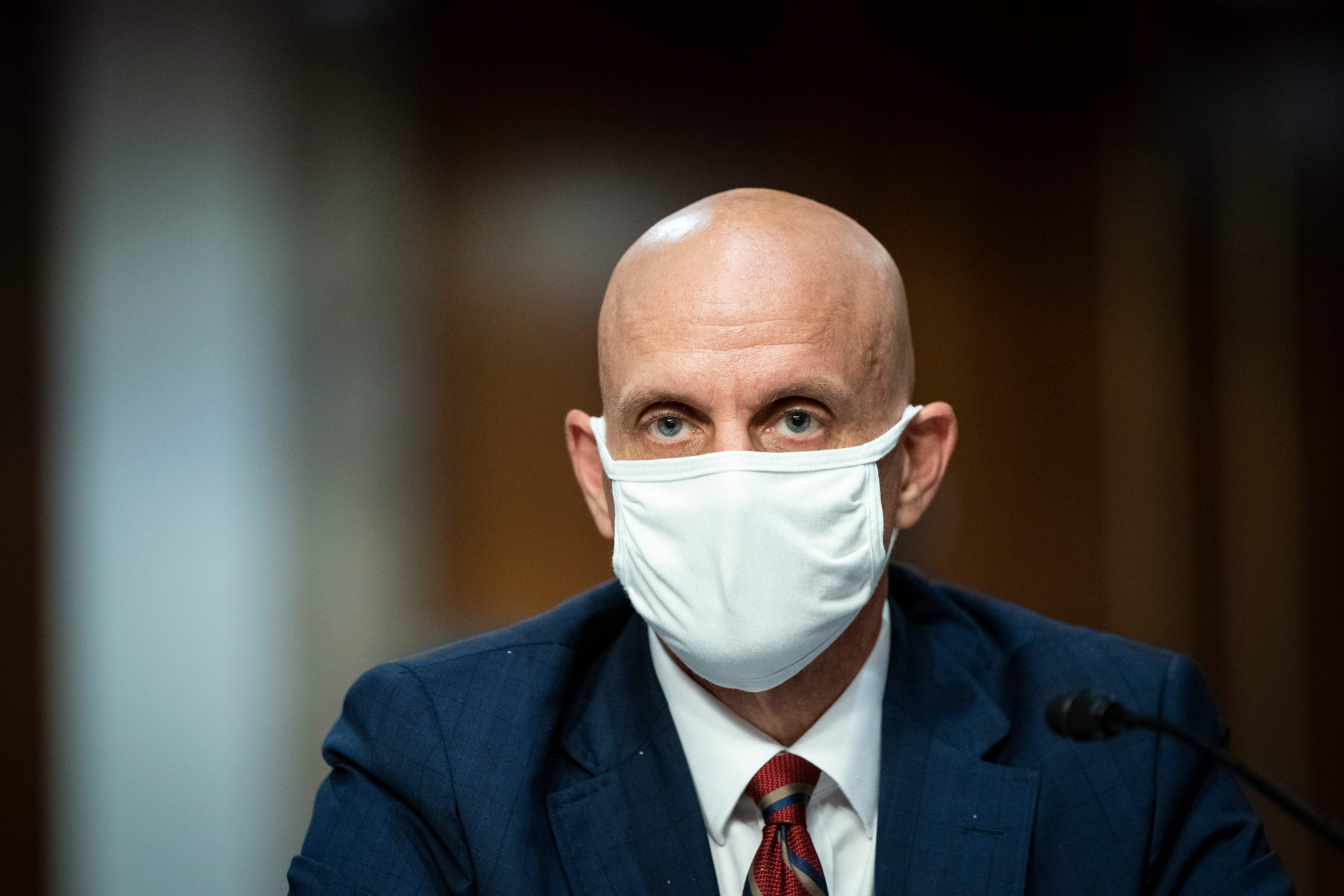 Stephen Hahn, commissioner of food and drugs at the US Food and Drug Administration (FDA), wears a protective covering during a Senate Health, Education, Labor and Pensions Committee hearing in Washington, D.C., on June 30.