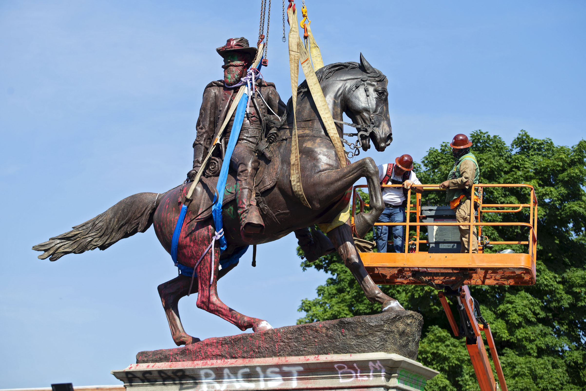 The statue of Confederate General J.E.B. Stuart is removed from Monument Avenue in Richmond, Va., on July 7, 2020