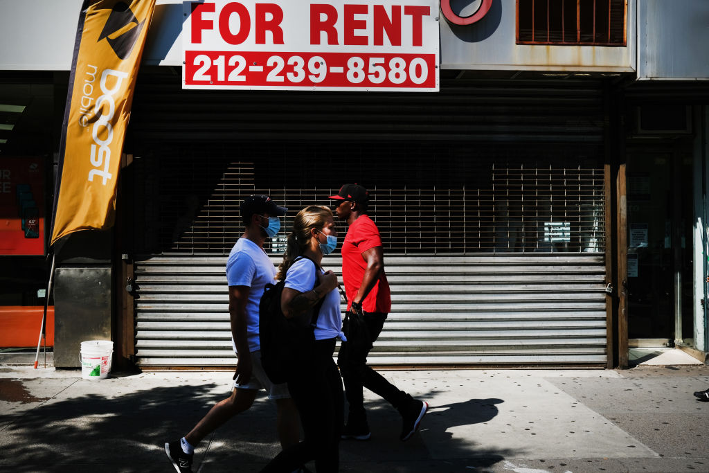 People walk by a closed business  on July 21, 2020 in the Brooklyn borough of New York City. As the United States economy continues to struggle due to the coronavirus pandemic, a surge in corporate bankruptcies is only adding to a difficult labor market.