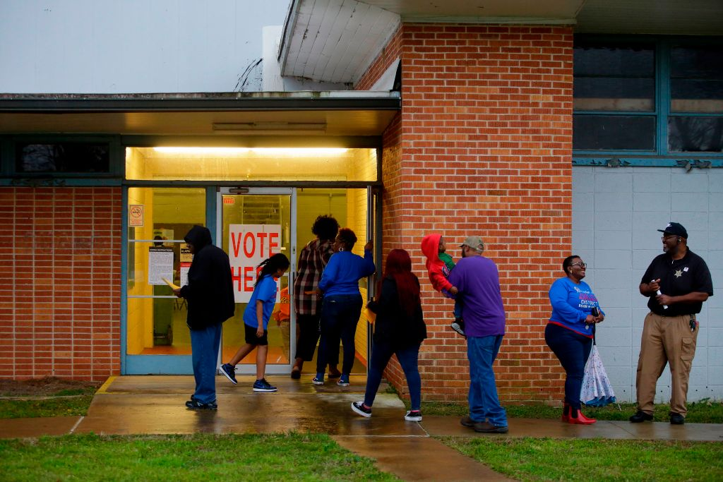 Voters enter a polling station at the National Guard Military Base during the presidential primary in Camden, Alabama on Super Tuesday, March 3, 2020.