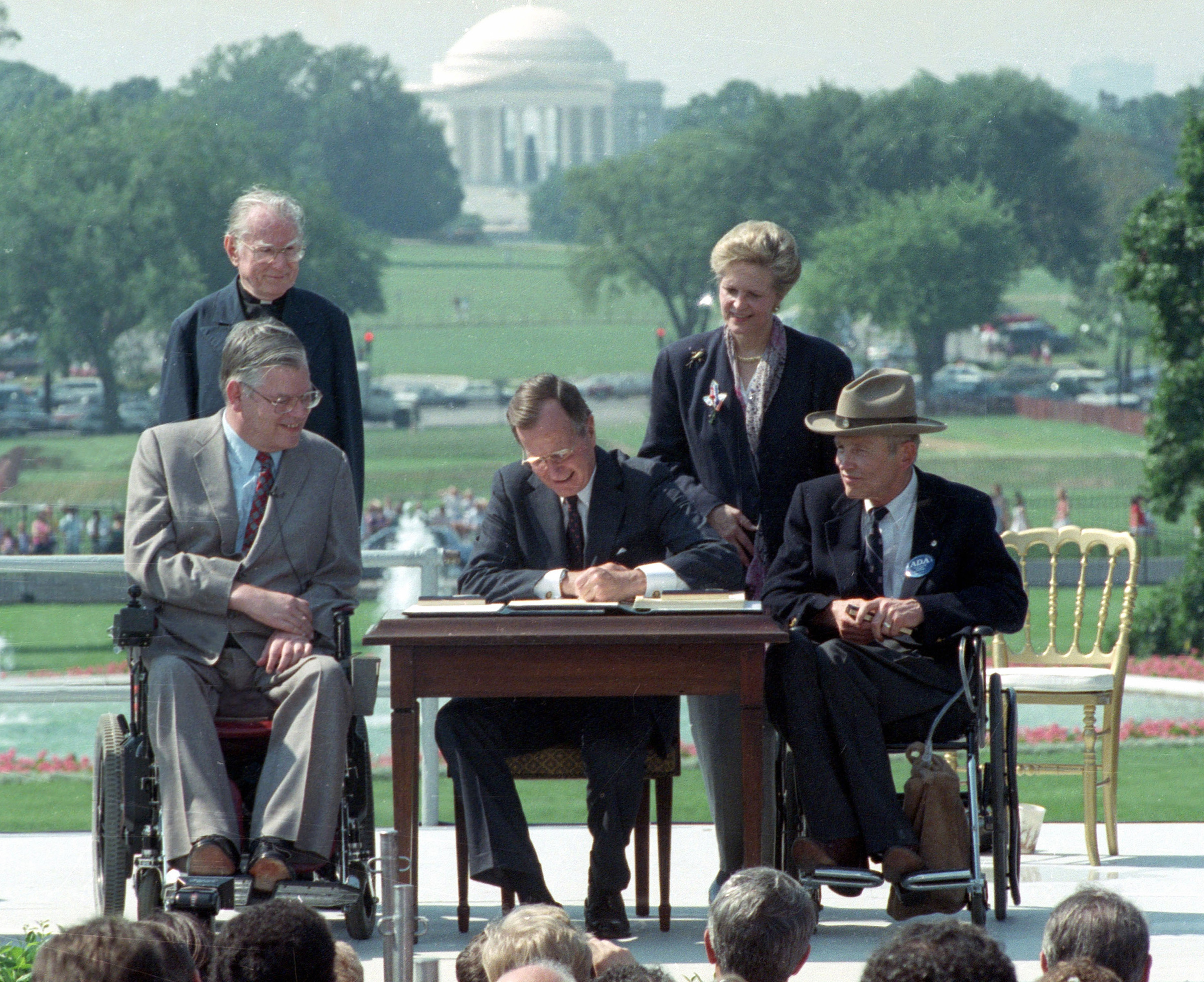 President George H.W. Bush signs the ADA in 1990