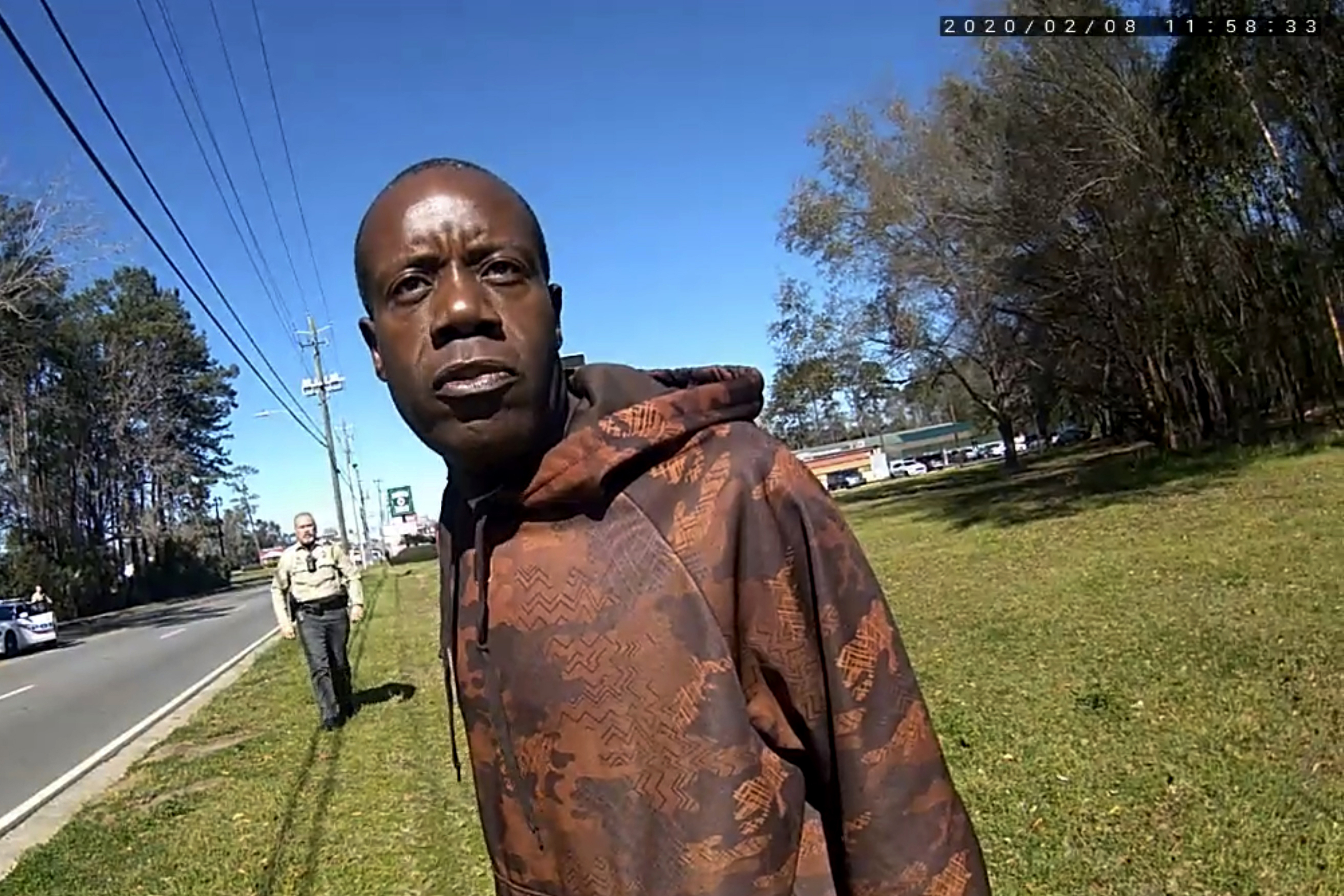 In this still image from a body camera video released by the Valdosta police, Antonio Arnelo Smith speaks to an officer as Sgt. Billy Wheeler approaches him from behind in Valdosta, Ga., on Feb. 8, 2020.