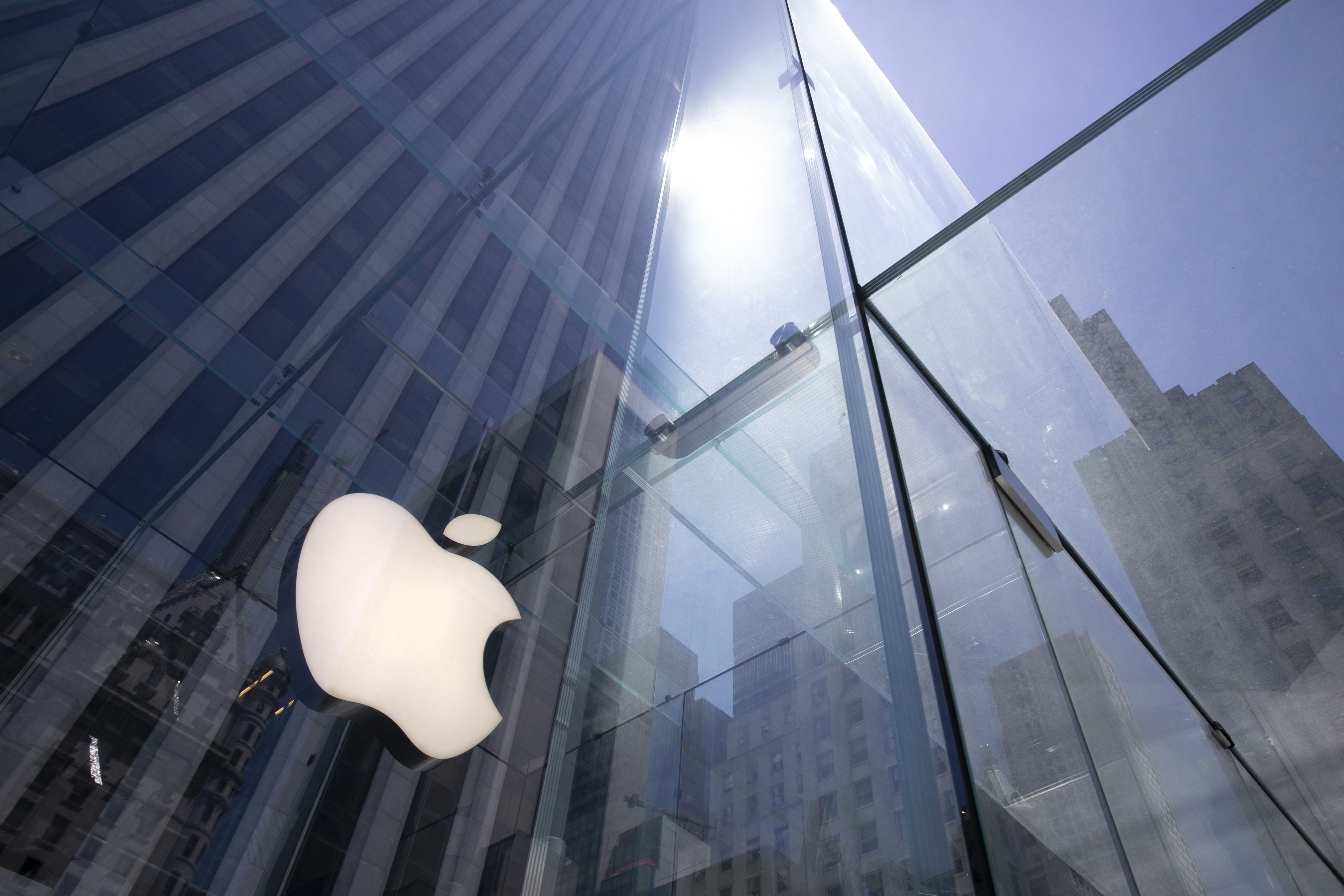 The sun is reflected on Apple's Fifth Avenue store in New York in this file photo from June 16, 2020.