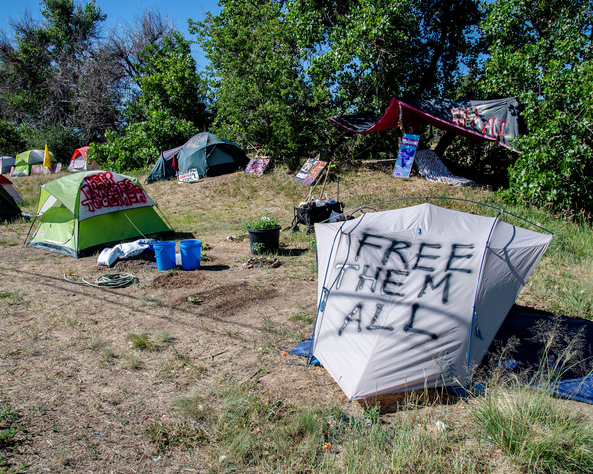 Protestors camp in tents outside of the Aurora ICE Processing Center in Aurora, Colorado on July 5, 2020.