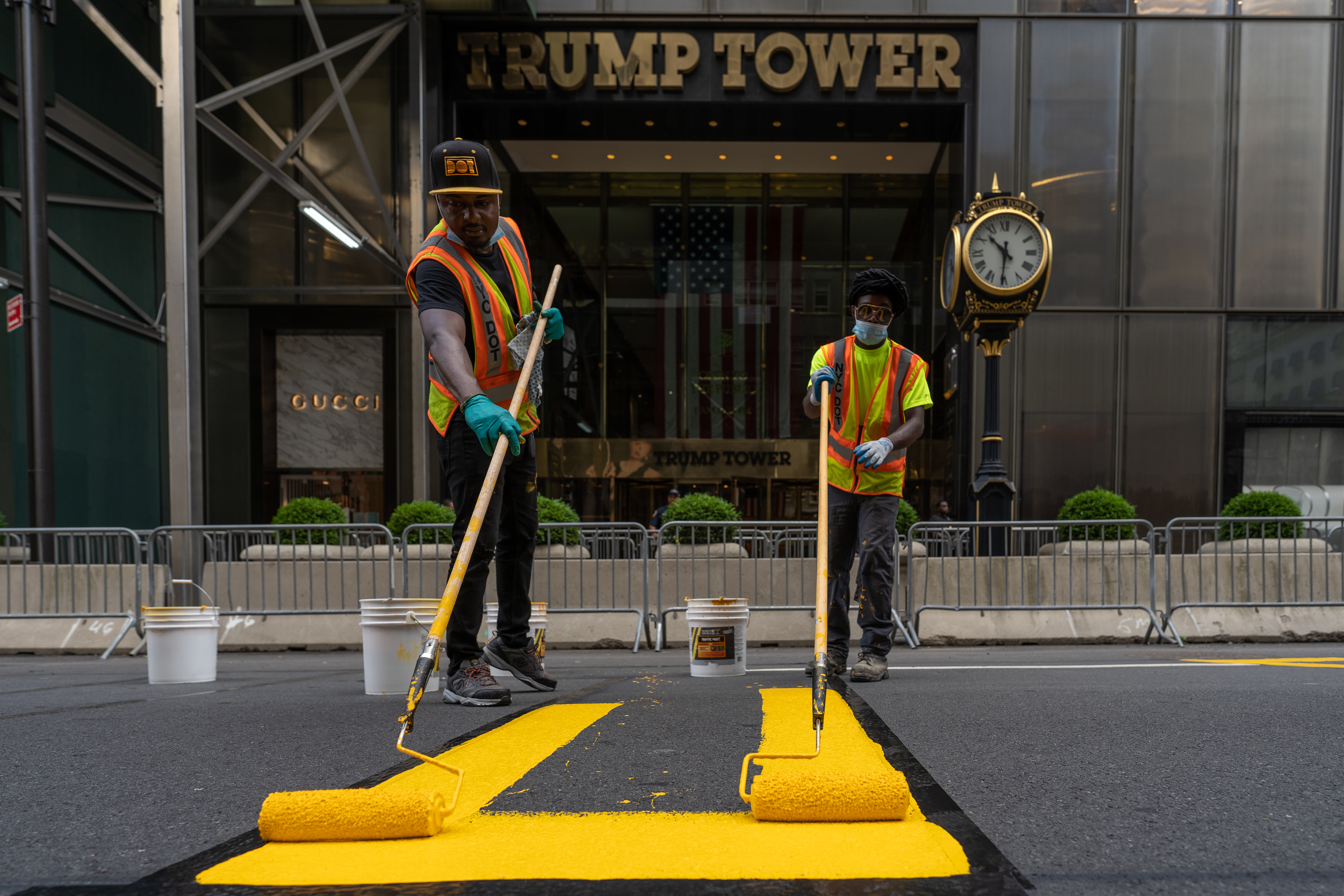 Crews begin painting a Black Lives Matter mural on Fifth Avenue directly in front of Trump Tower on July 9, 2020 in New York City.