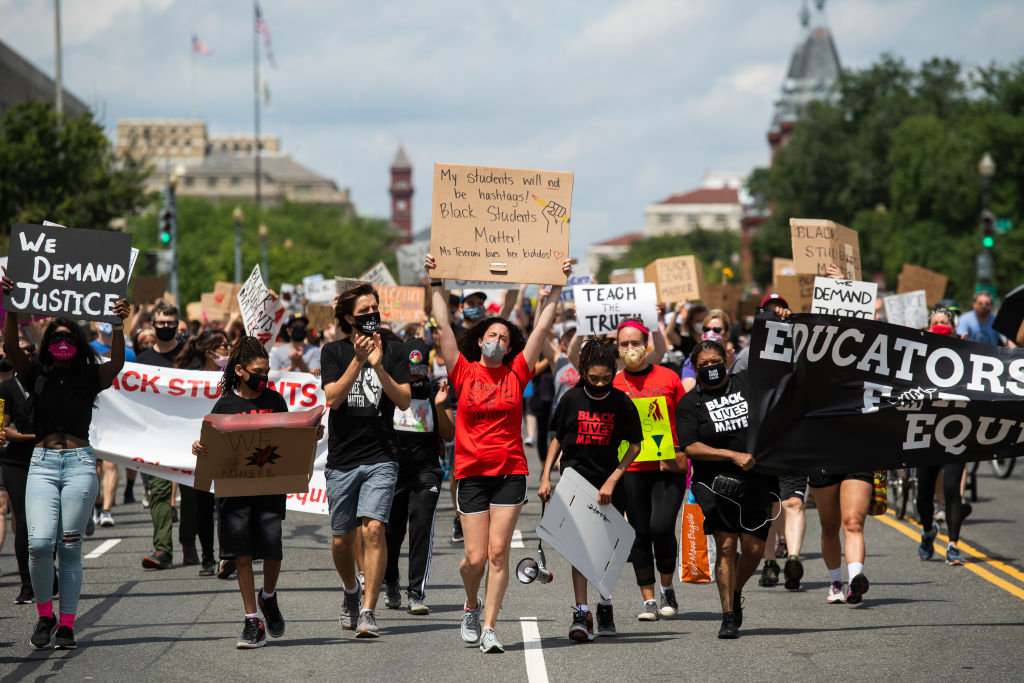 Demonstrators march towards the U.S. Department of Education as part of the Black Students Matter rally, which was organized by Educators for Equity on June 19, 2020, in Washington, D.C.