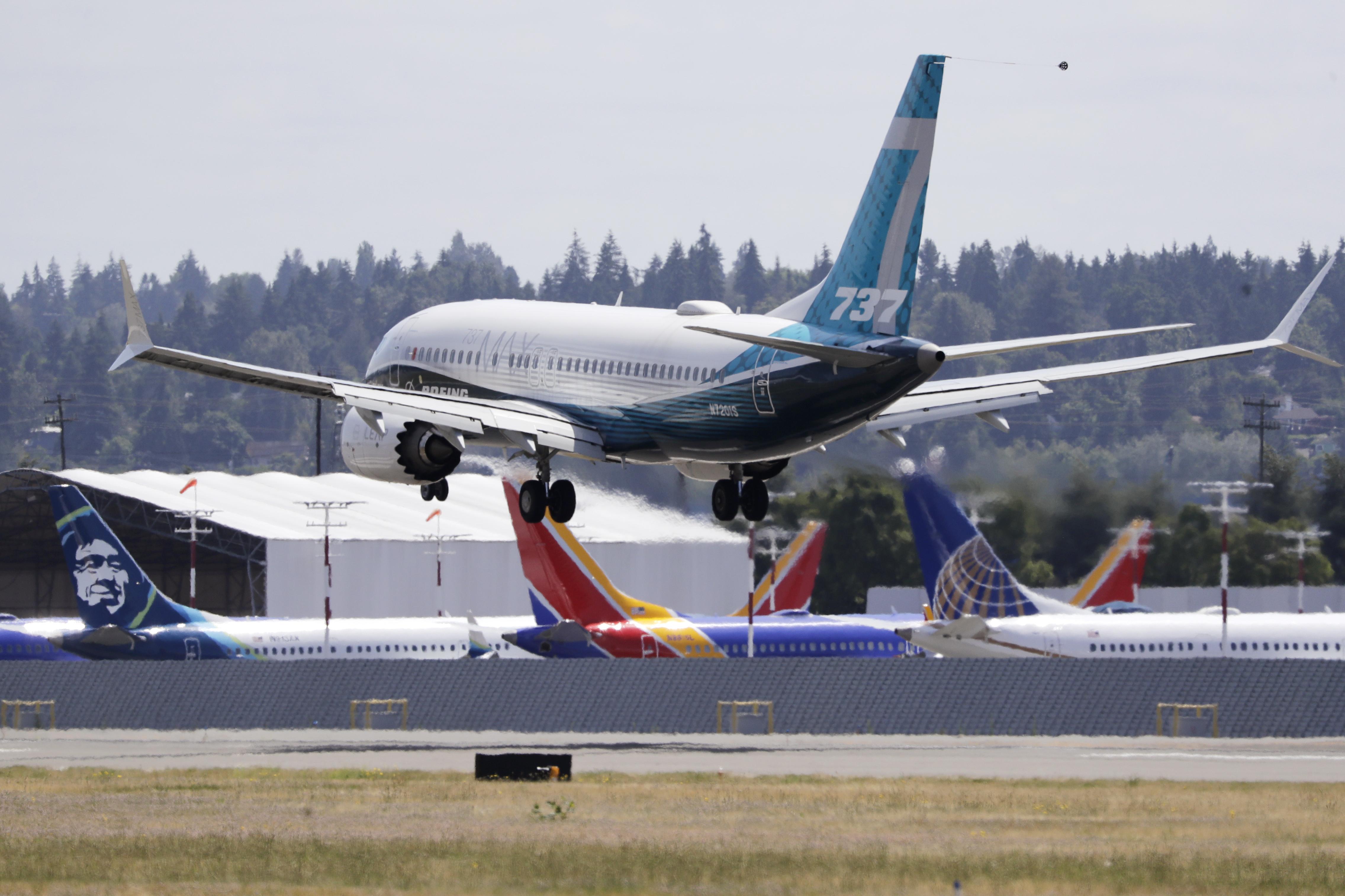 A Boeing 737 MAX jet lands behind a Boeing Field following a test flight in Seattle on June 29, 2020.