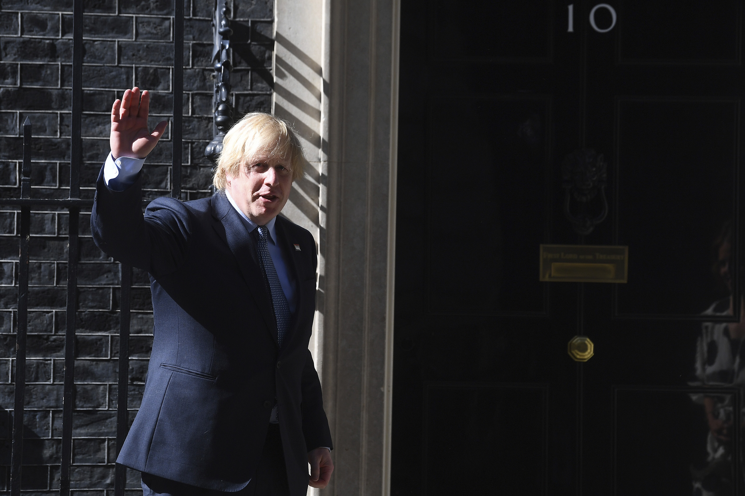 Prime Minister, Boris Johnson joins in the pause for applause to salute the NHS in London on July 5, 2020.