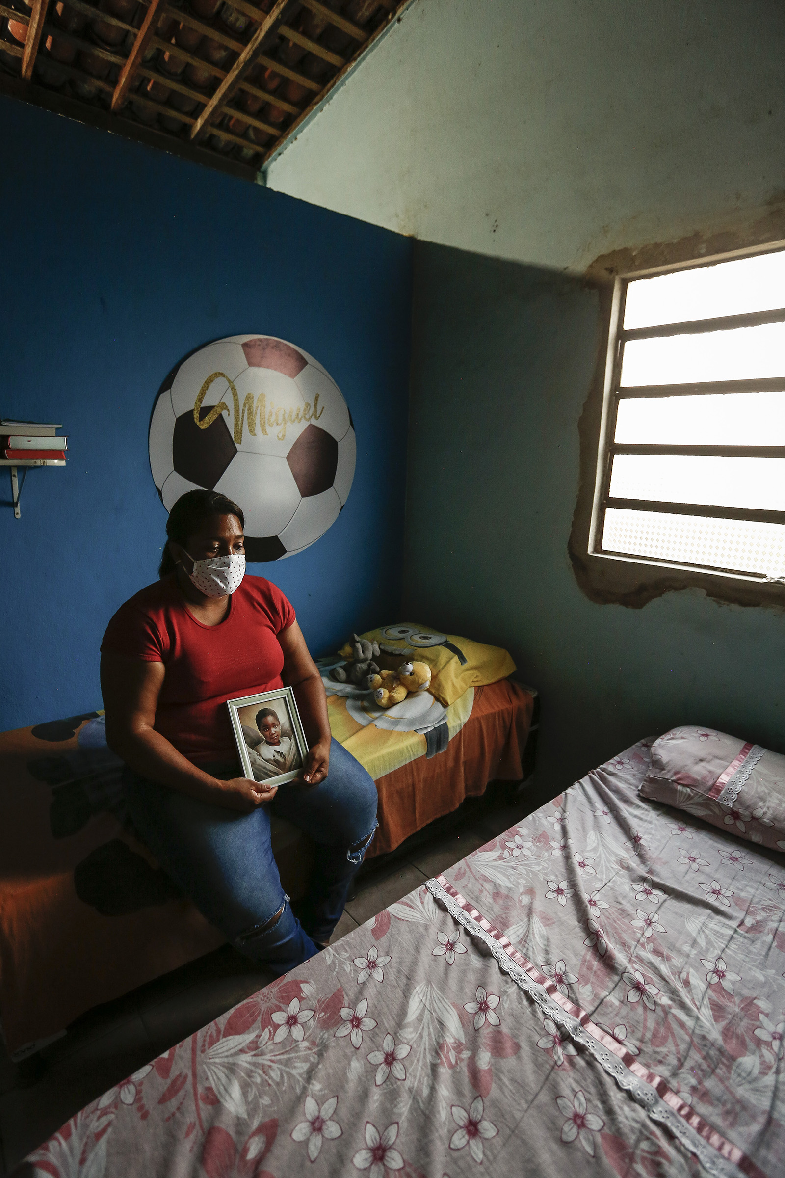 Mirtes Renata Santana de Souza holding a photo of her son Miguel at her home in the neighborhood of Sucupira, south of Recife, Brazil on July 2, 2020.