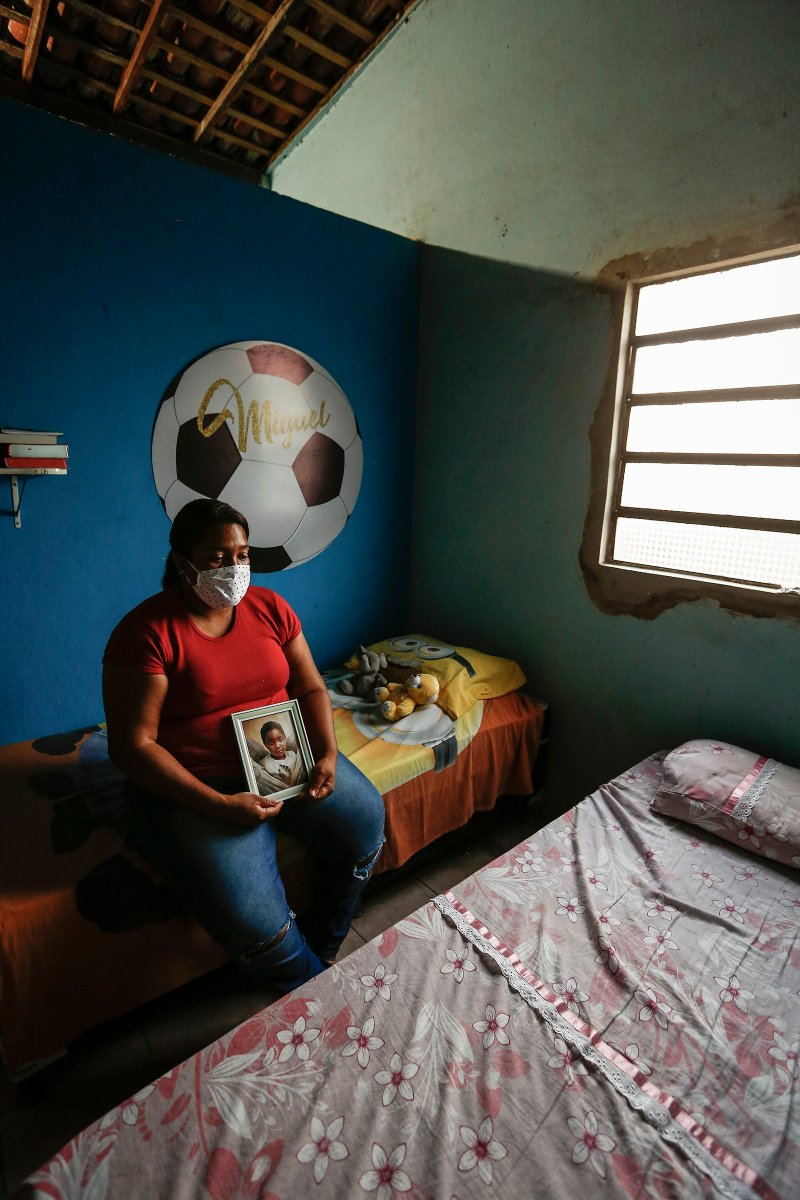 Mirtes Renata Santana de Souza holding a photo of her son Miguelat her home in the neighborhood of Sucupira, south of Recife, Brazil on July 2, 2020.