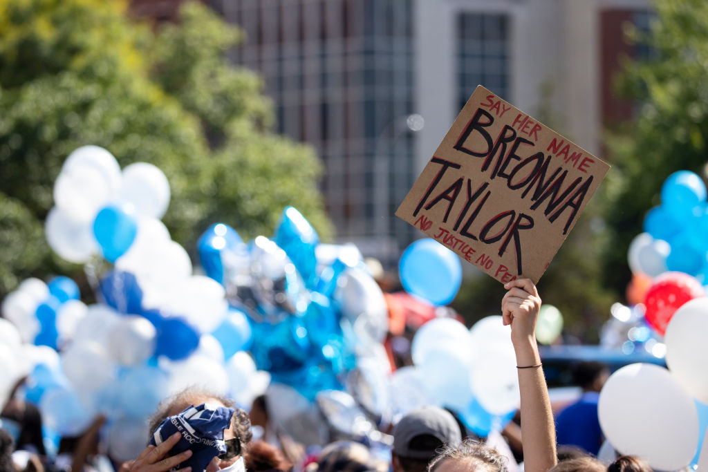 People gather with balloons for a vigil in memory of Breonna Taylor on June 6, 2020 in Louisville, Kentucky.